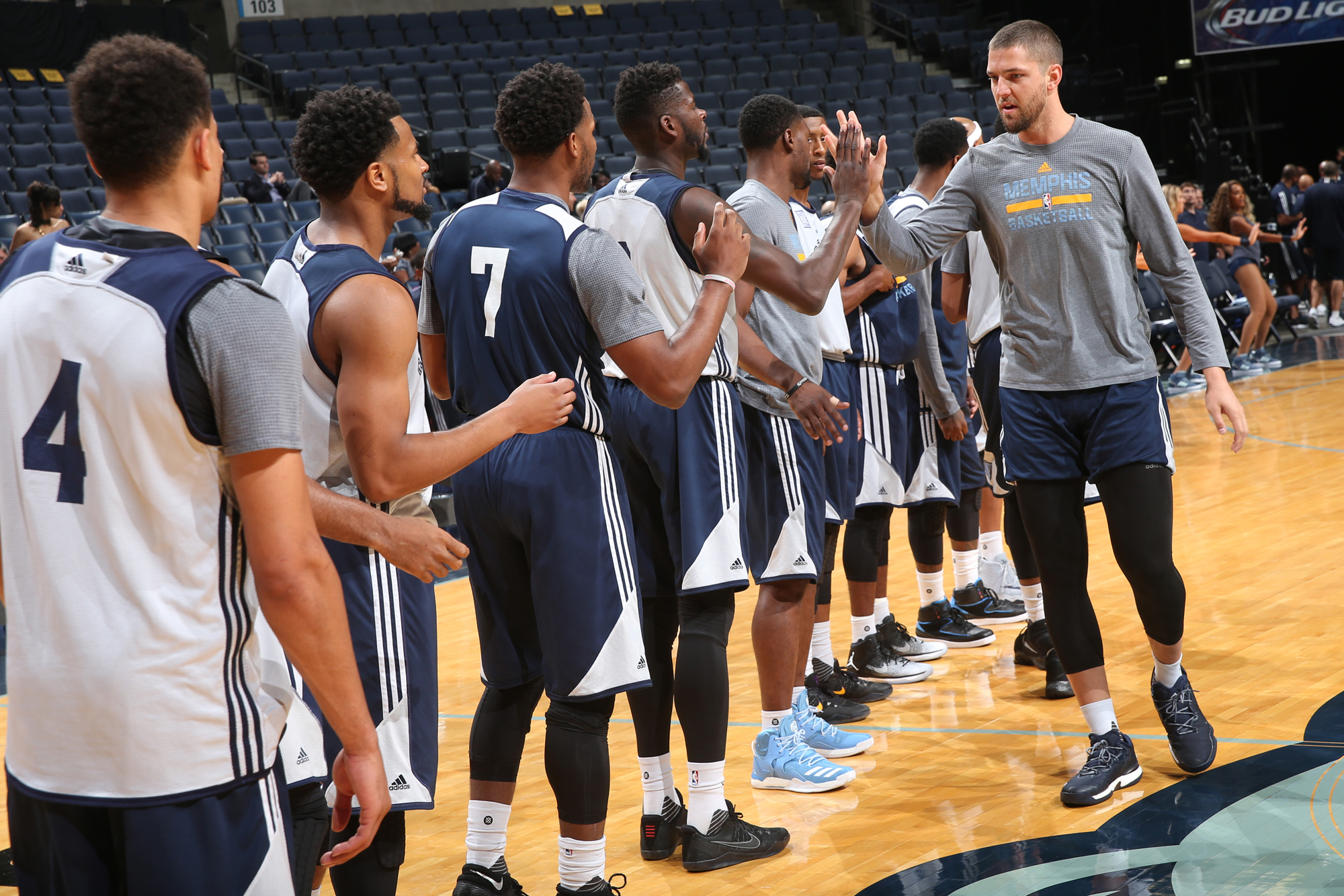 Chandler Parsons #25 of the Memphis Grizzlies high fives teammates during an open practice on October 1, 2016 at FedExForum in Memphis, Tennessee.