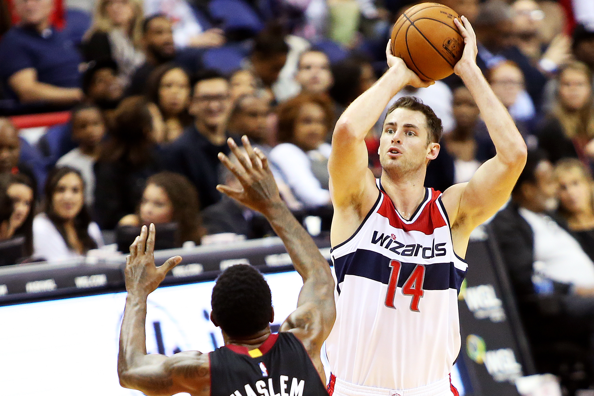 1b5e5fddb Washington Wizards forward Jason Smith (14) takes a shot over Miami Heat  forward Udonis