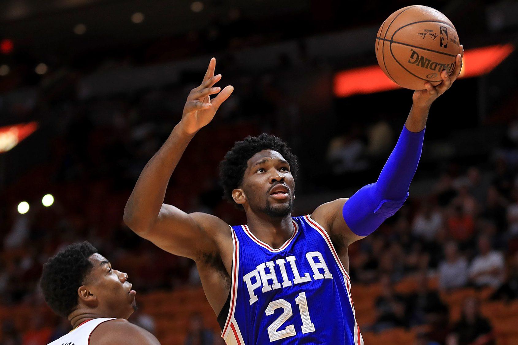 e58632ce5 Joel Embiid  21 of the Philadelphia 76ers drives on Hassan Whiteside  21 of  the