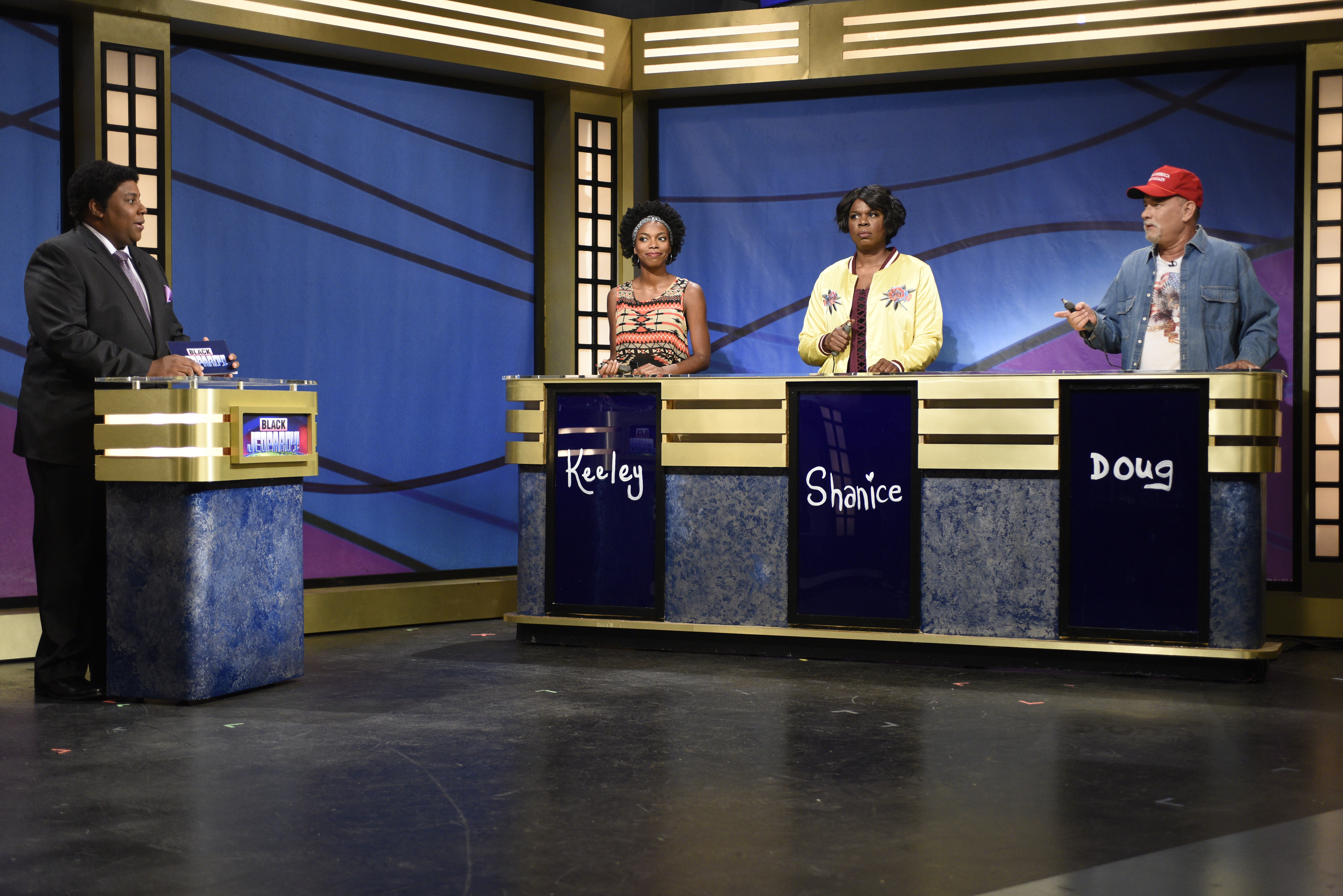 "Kenan Thompson as Darnell Hayes, Sasheer Zamata as Keely, Leslie Jones as Shanice, and Tom Hanks as Doug during the ""Black Jeopardy"" sketch on October 22, 2016."