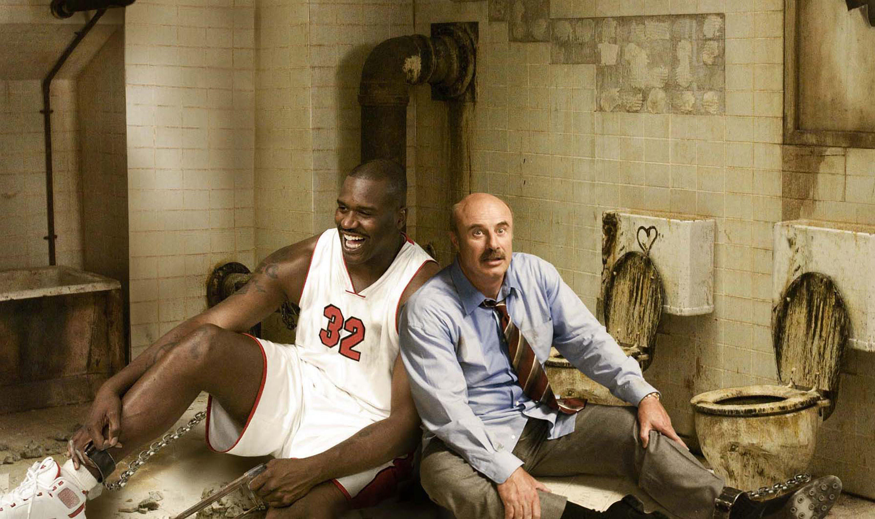 Shag (SHAQUILLE O'NEAL) and Dr. Phil (DR. PHIL MCGRAW) spoofing 'Saw' in a scene from SCARY MOVIE 4