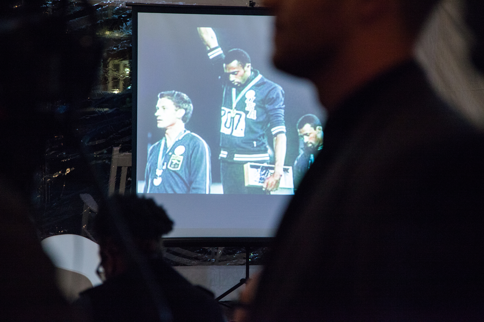 An iconic image of Dr. John Carlos is seen projected on to a screen at an event held in Winston-Salem, NC on October 14, 2016. The event was small and personal, held in a tent where the topic of gender and race in the Olympics, was held.