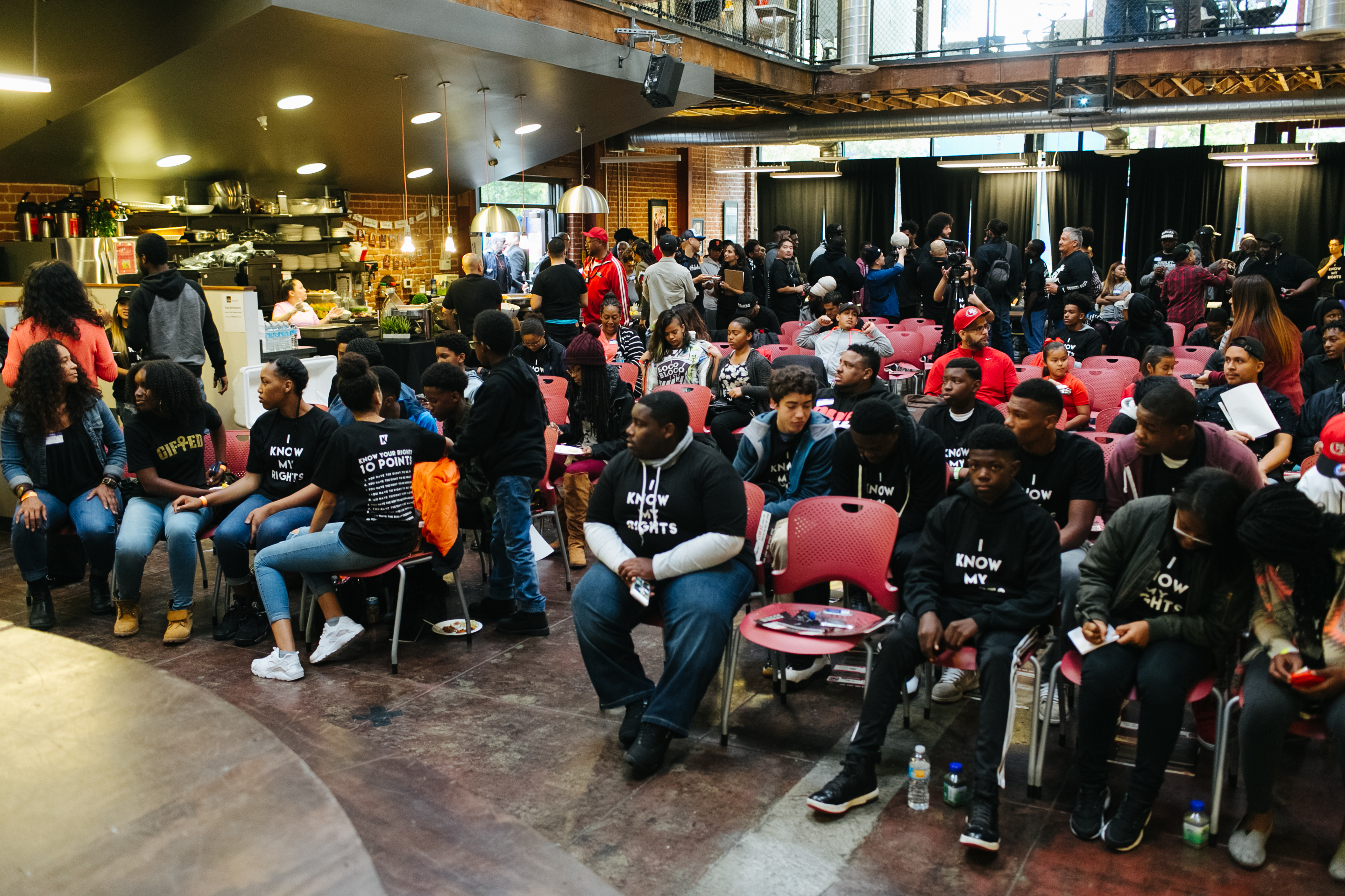 Invited children and teenagers sit while waiting for the event to begin at the HUB Oakland on September 29, 2016.