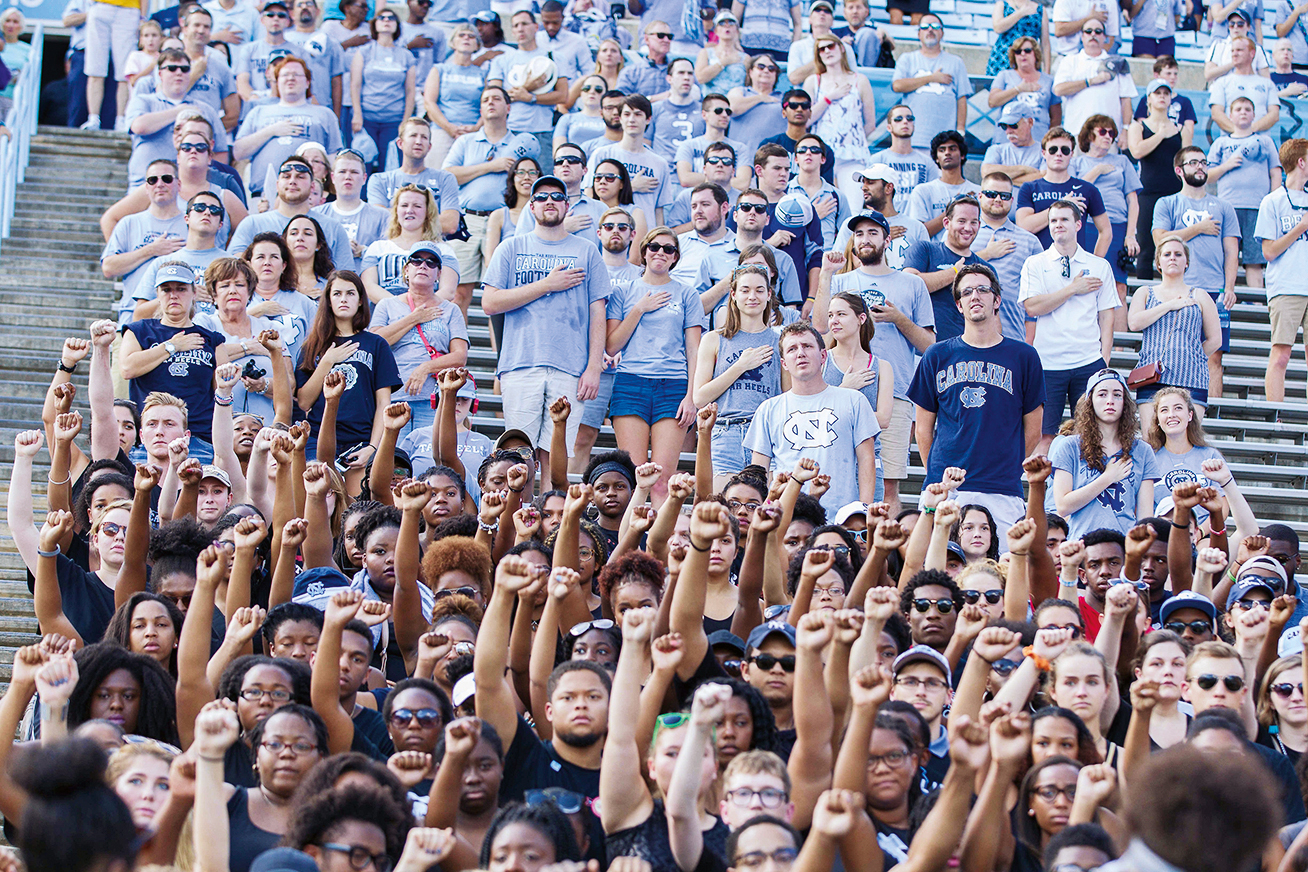 North Carolina Tar Heels students hold up their fists during the national anthem in silent protest during the game against the Pittsburgh Panthers at Kenan Memorial Stadium.