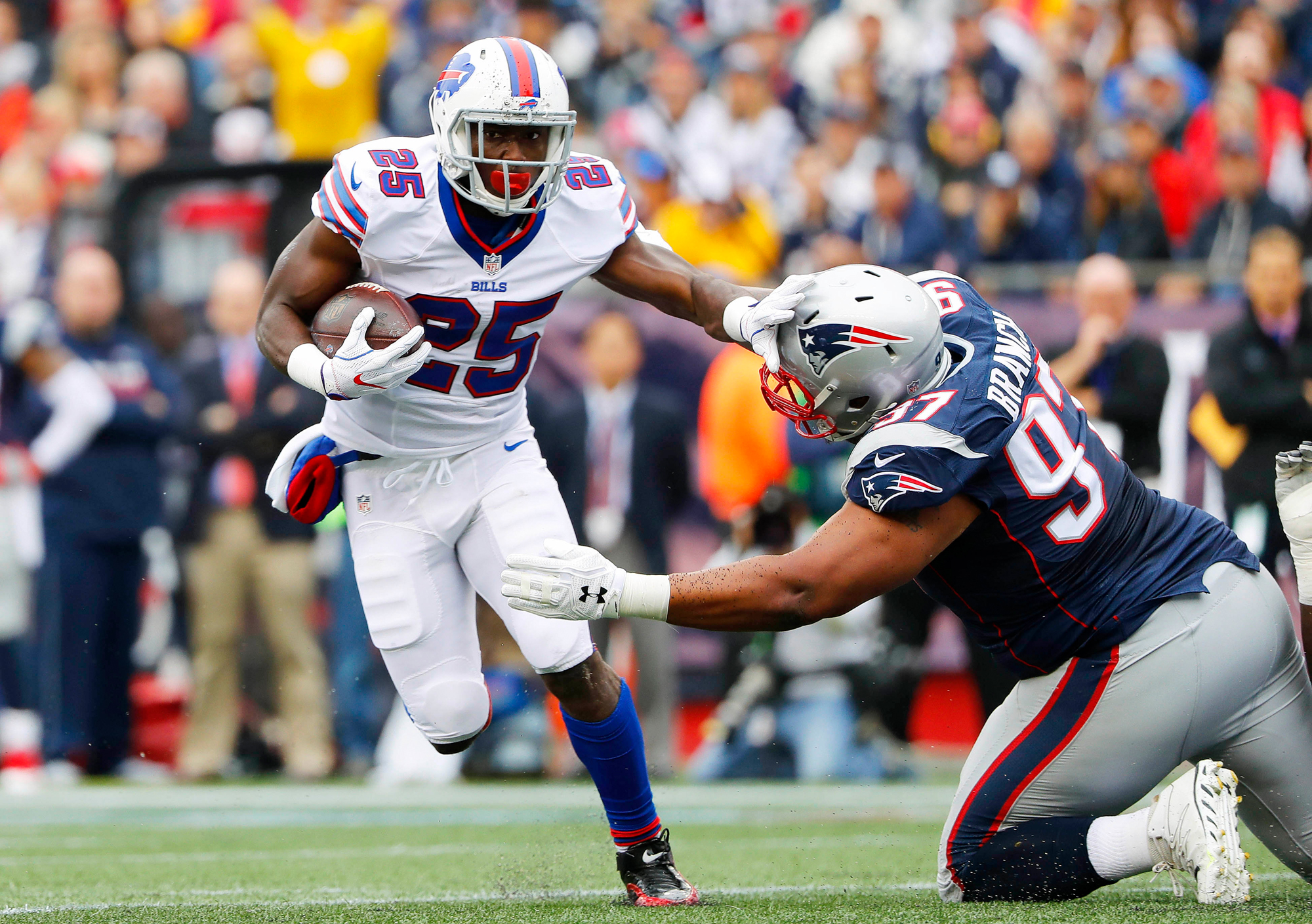 Buffalo Bills running back LeSean McCoy (25) tries to shed New England Patriots defensive tackle Alan Branch (97) during the first half at Gillette Stadium.