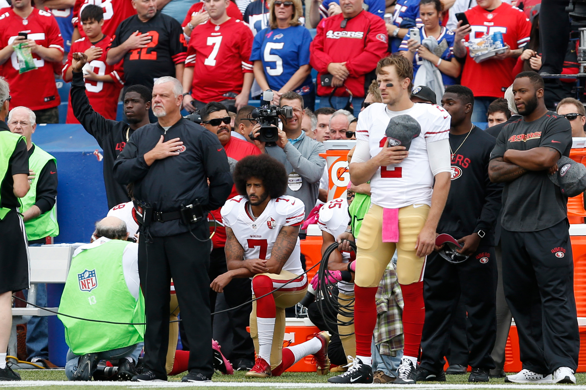 Orchard Park, NY, USA; San Francisco 49ers quarterback Colin Kaepernick (7) and quarterback Blaine Gabbert (2) react before a game against the Buffalo Bills at New Era Field.