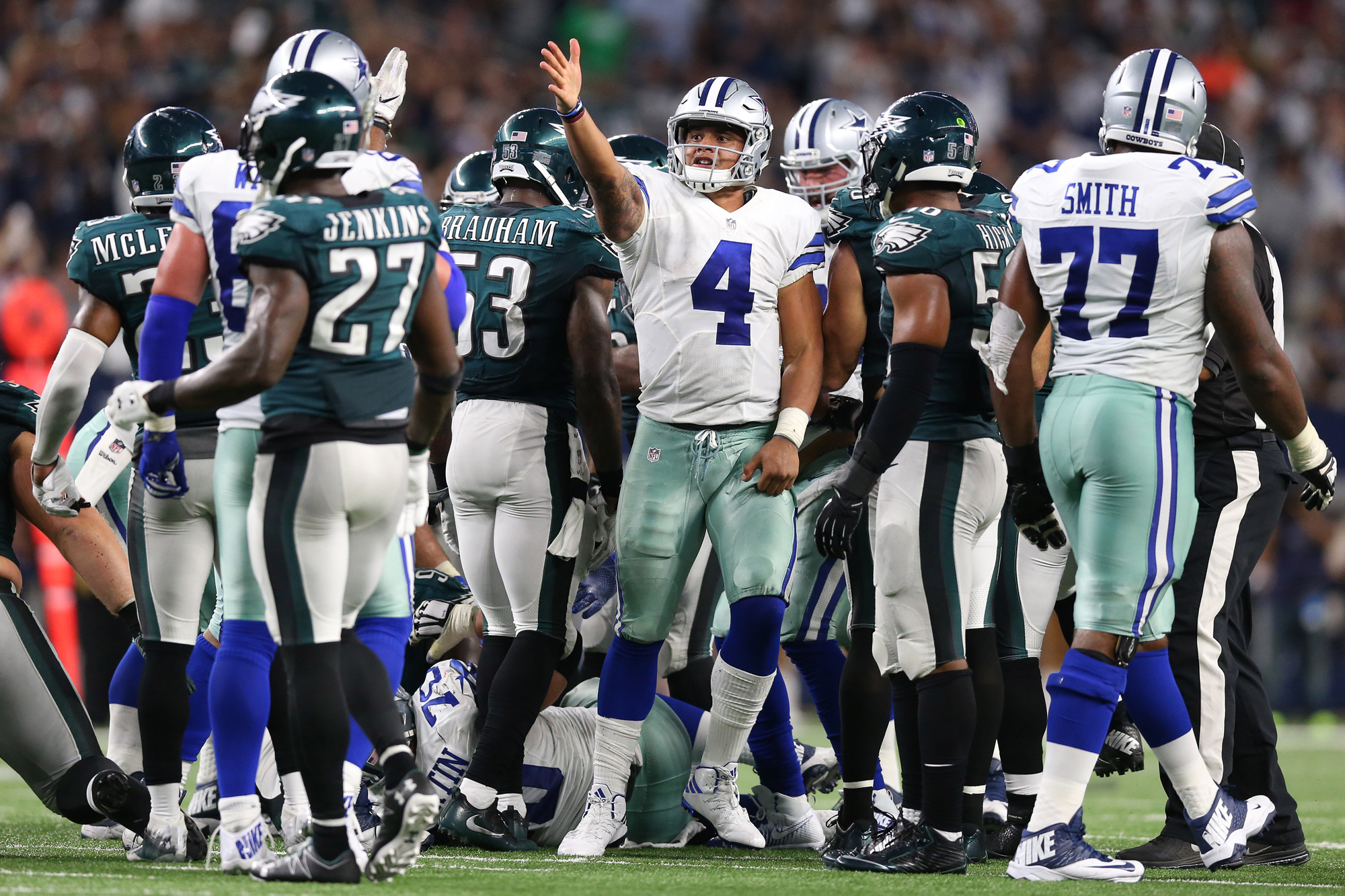 Dallas Cowboys quarterback Dak Prescott (4) signals a first down in overtime after a quarterback sneak on fourth down against the Philadelphia Eagles at AT&T Stadium. The Cowboys beat the Eagles 29-23 in overtime.