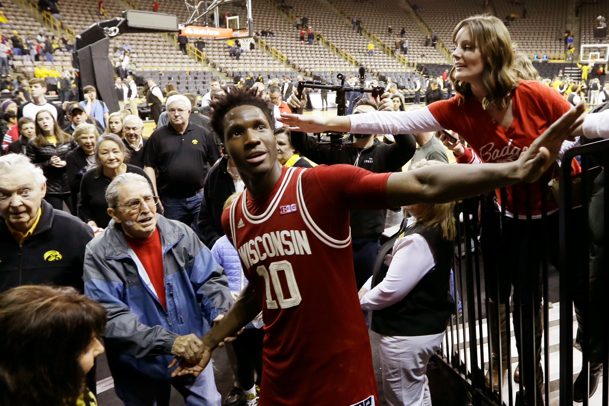 Wisconsin forward Nigel Hayes celebrates with fans after an NCAA college basketball game against Iowa, Wednesday, Feb. 24, 2016, in Iowa City, Iowa.
