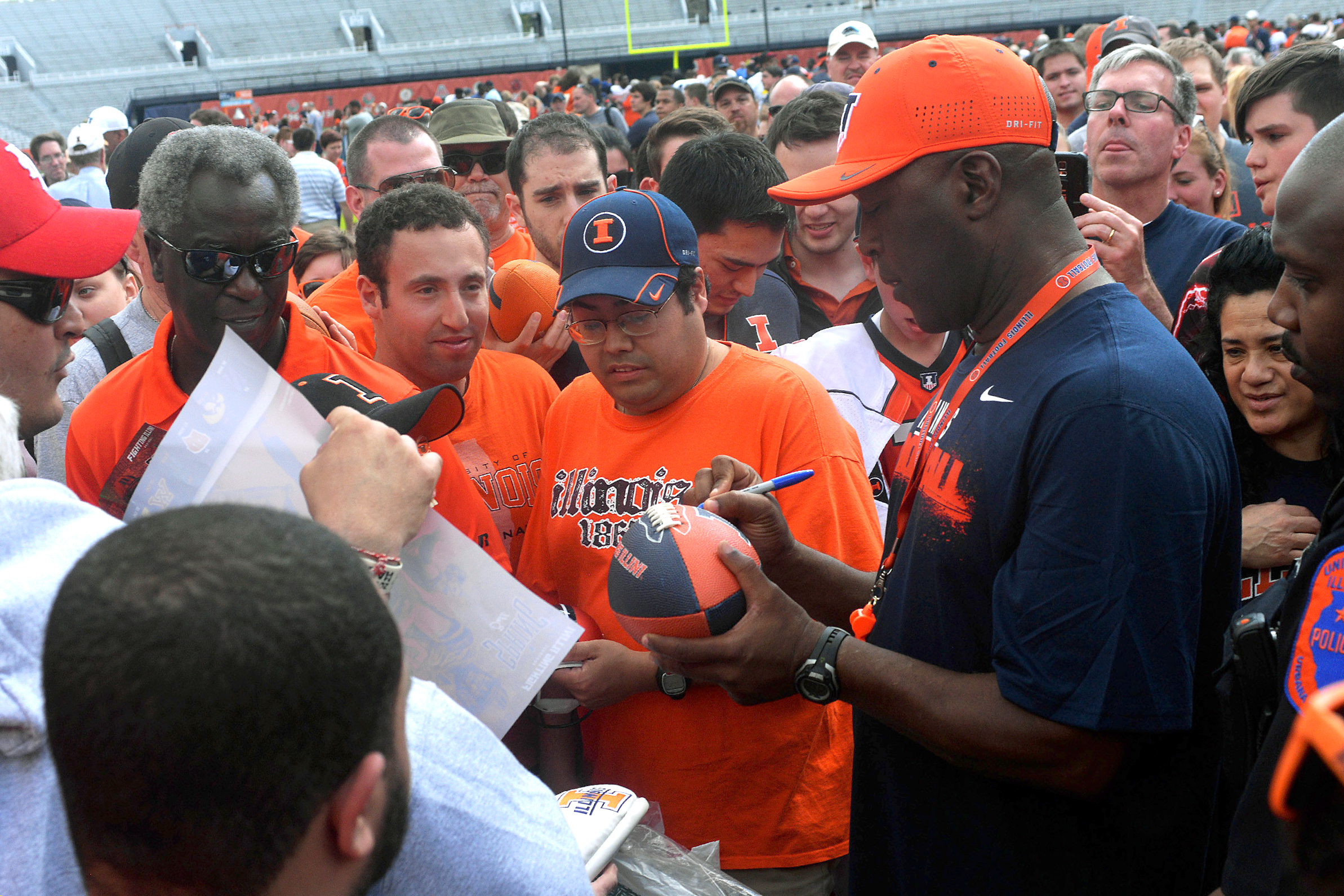 Illinois Fighting Illini Head Coach Lovie Smith signs autographs after the Spring football game at Memorial Stadium in Champaign, Illinois.
