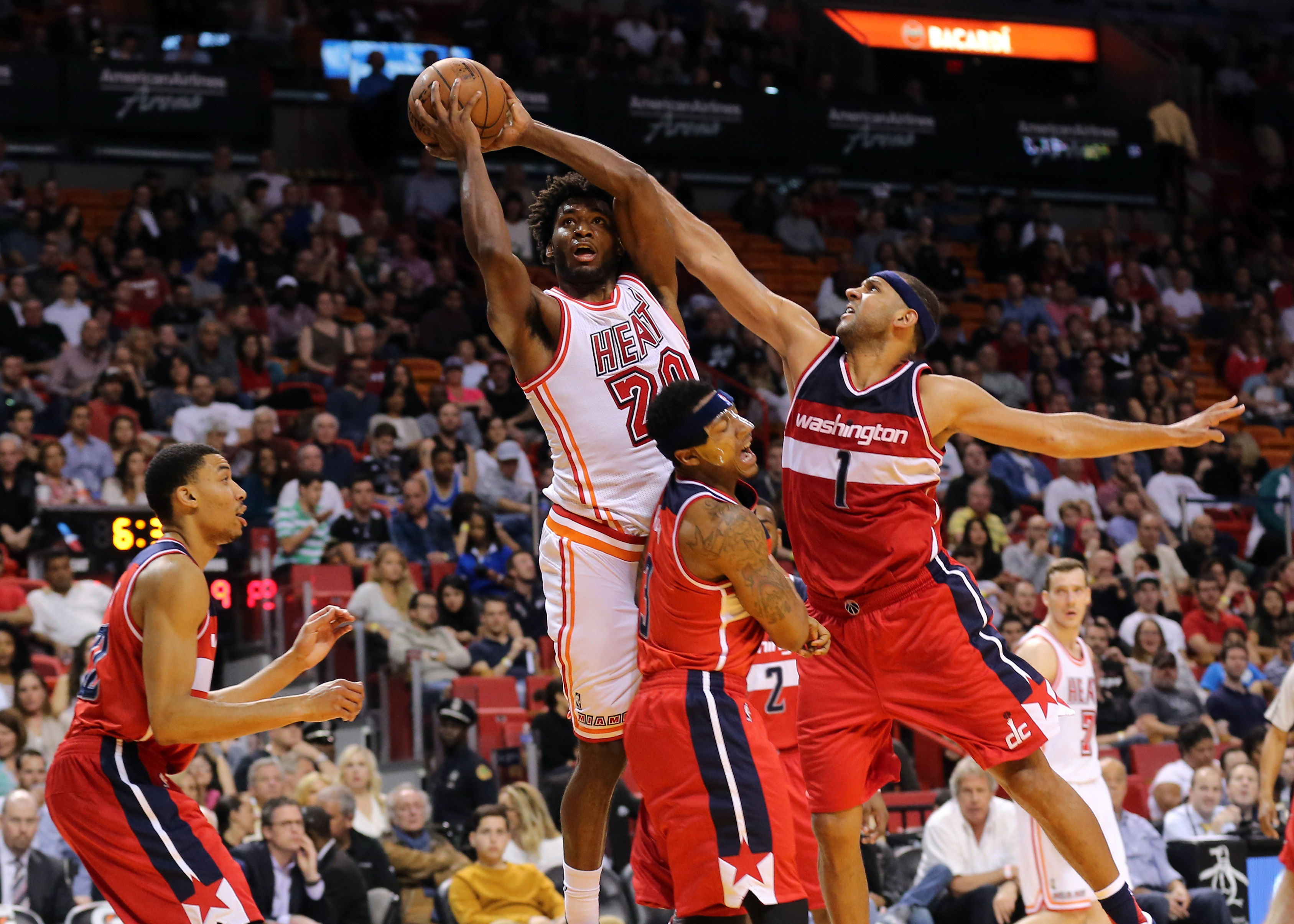 Miami Heat forward Justise Winslow (20) is fouled by Washington Wizards forward Jared Dudley (1) during the second half at American Airlines Arena.