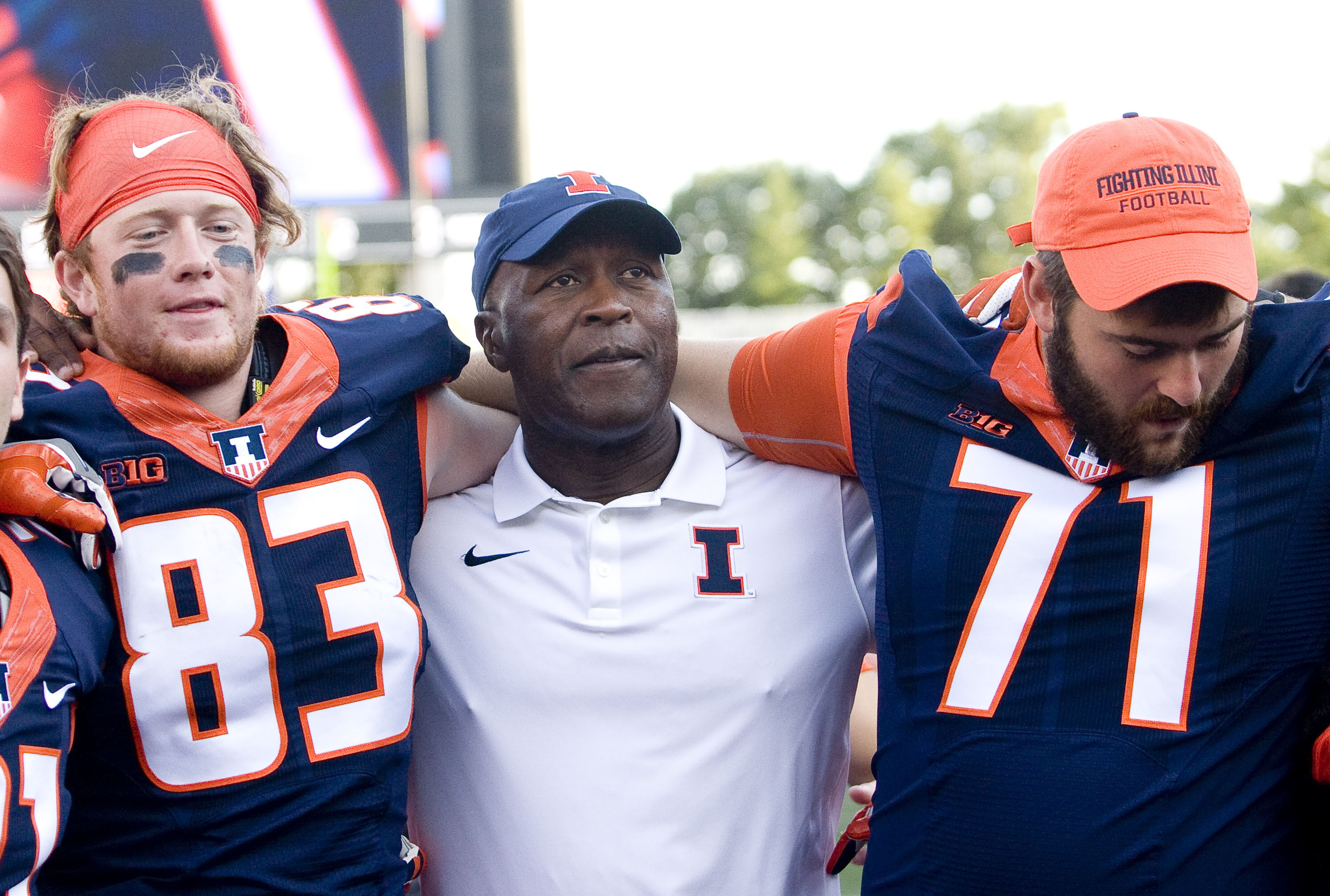 Illinois Fighting Illini wide receiver Samuel Harlib (82) and Illinois Fighting Illini offensive lineman Joe Spencer (71) celebrate with head coach Lovie Smith after the game against the Murray State Racers at Memorial Stadium.