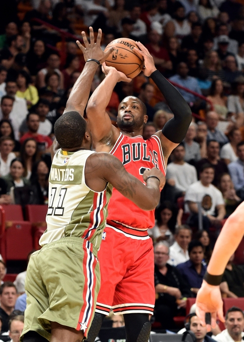 Nov 10, 2016; Miami, FL, USA; Chicago Bulls guard Dwyane Wade (3) shoots over Miami Heat guard Dion Waiters (11) during the first half at American Airlines Arena. Mandatory Credit: Steve Mitchell-USA TODAY Sports