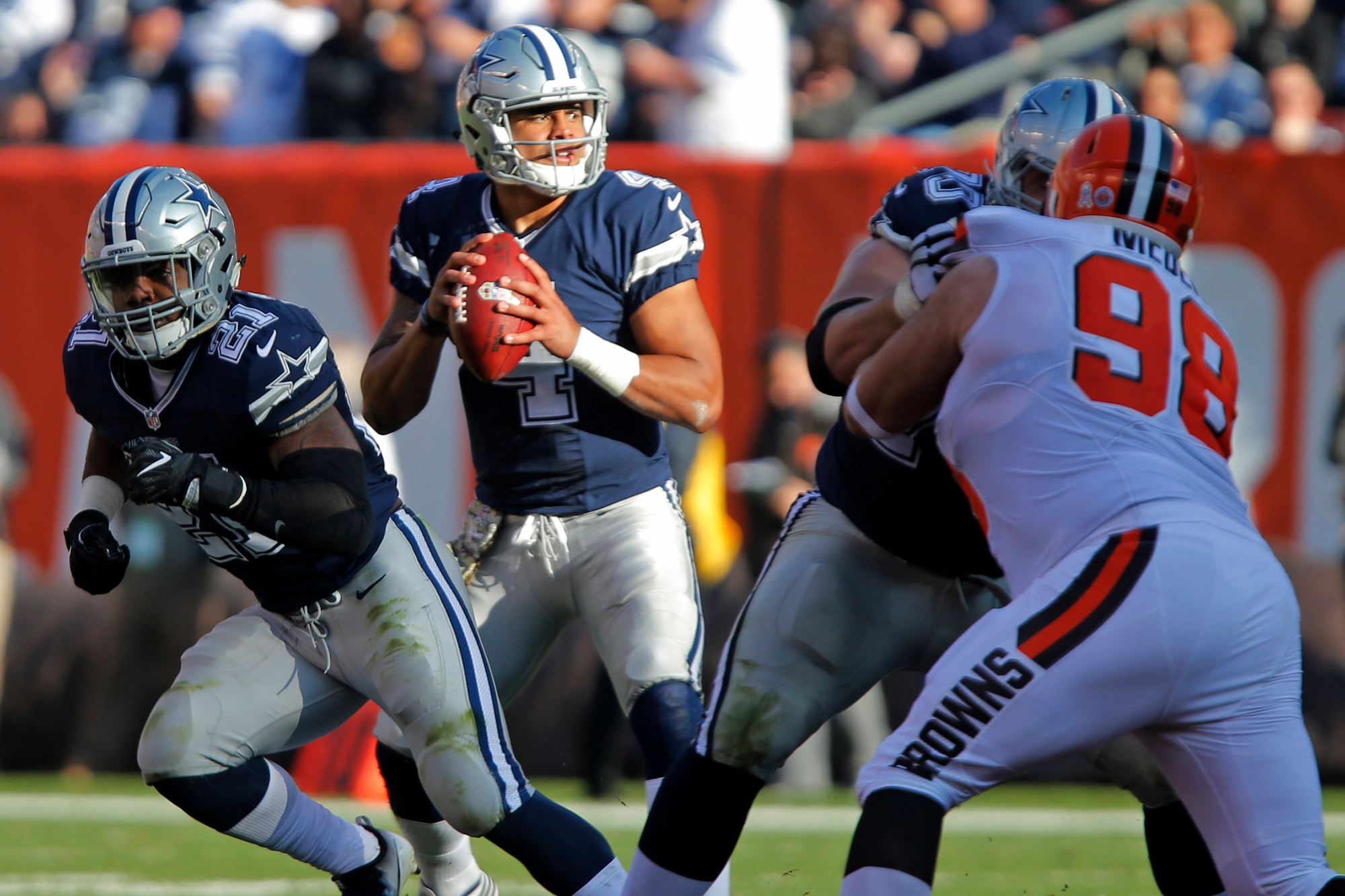 Dallas Cowboys quarterback Dak Prescott (4) looks to pass in the third quarter as the Dallas Cowboys defeat the Cleveland Browns 35-10 on Sunday, Nov. 6, 2016 in FirstEnergy Stadium in Cleveland, Ohio.