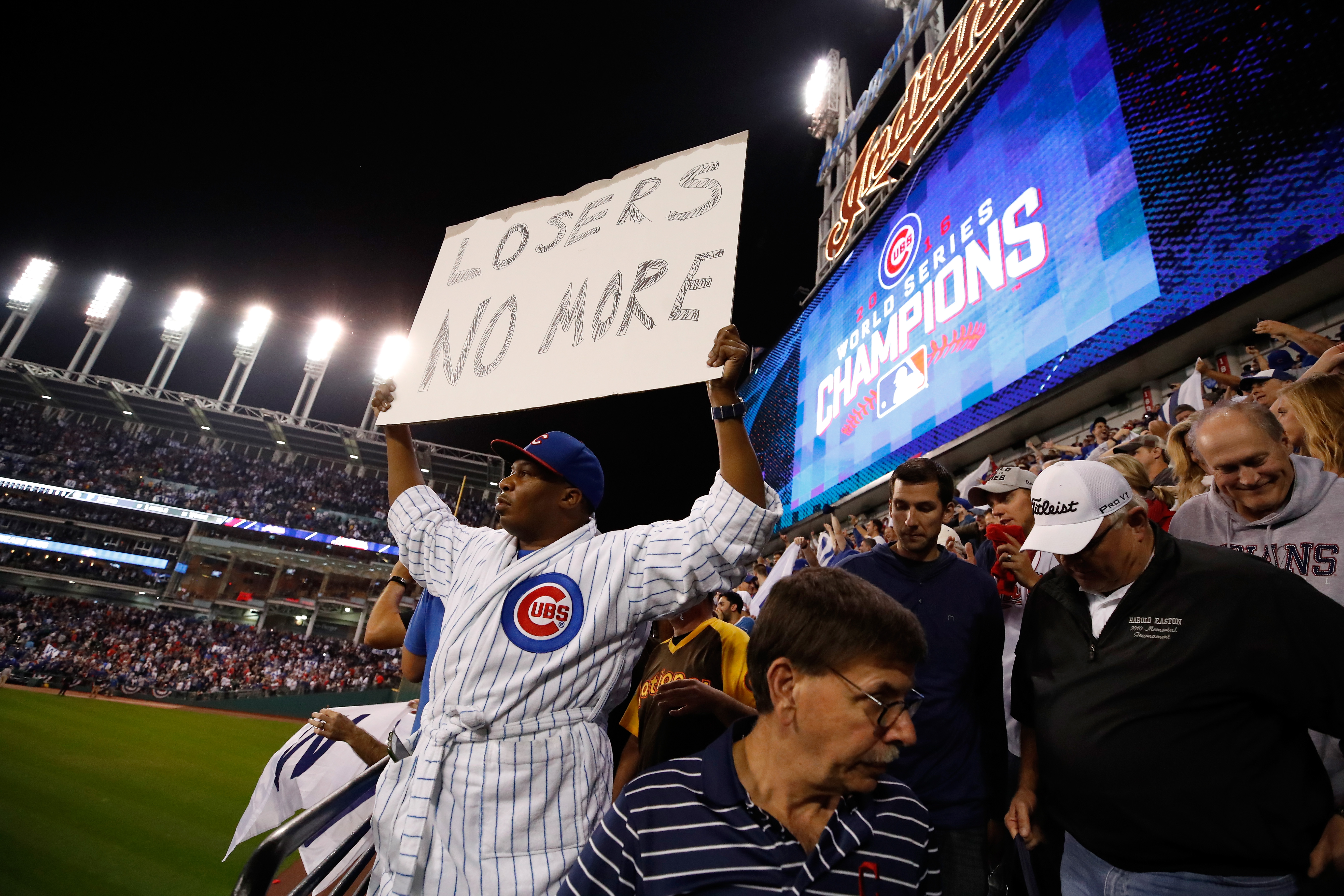 A Chicago Cubs fan holds a sign after the Cubs defeated the Cleveland Indians 8-7 in Game Seven of the 2016 World Series at Progressive Field on November 2, 2016 in Cleveland, Ohio. The Cubs win their first World Series in 108 years.