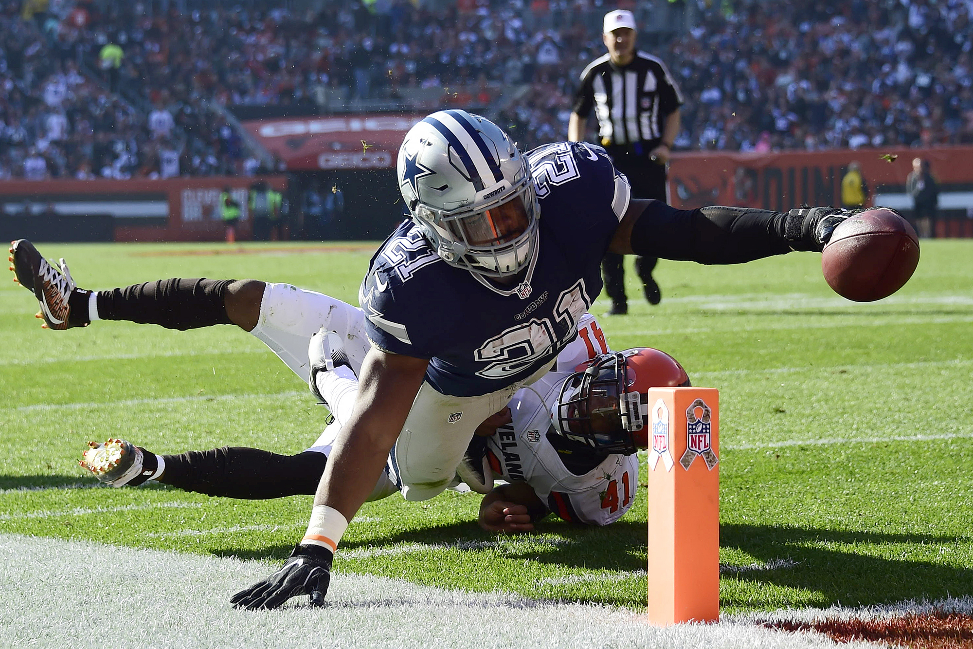 Ezekiel Elliott #21 of the Dallas Cowboys dives for a 10 yard touchdown in the first half against the Cleveland Browns at FirstEnergy Stadium on November 6, 2016 in Cleveland, Ohio.