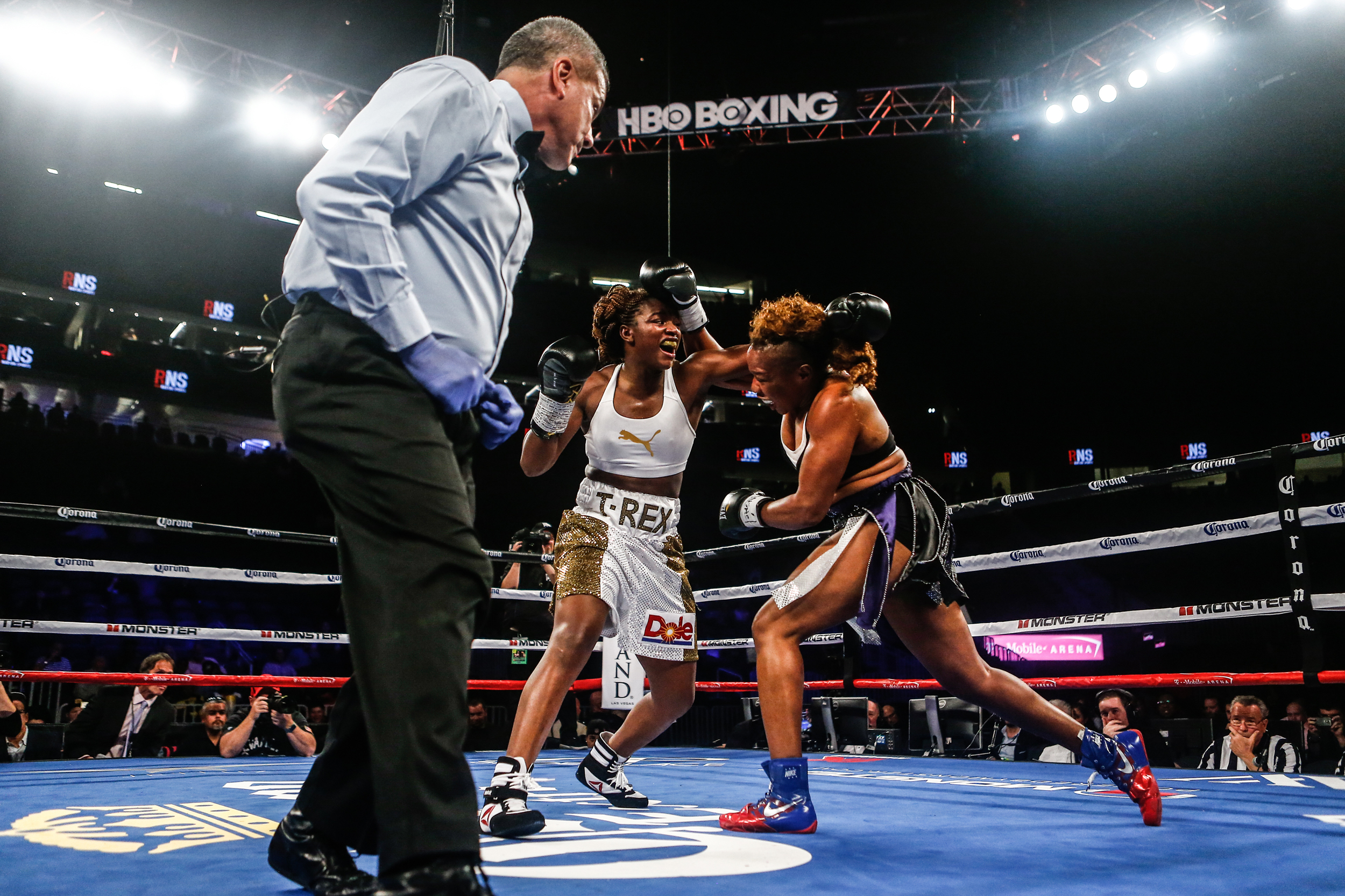 Claressa Shields, two-time Olympic gold medalist boxer, fights opponent Franchon Crews inside the ring in a four-round bout on November 19th at the T-Mobile Arena in Las Vegas.