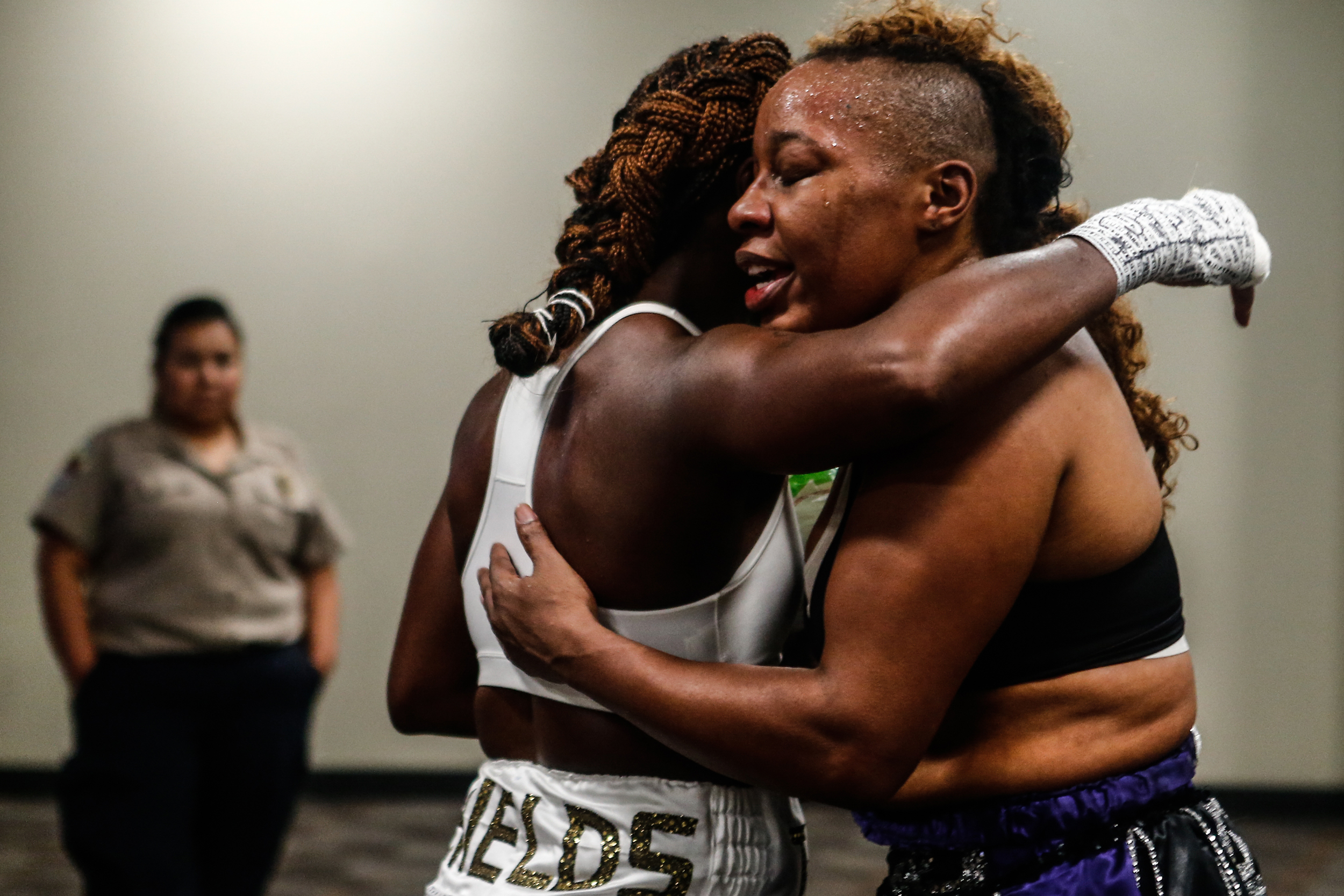 Claressa Shields, two-time Olympic gold medalist boxer, and opponent Franchon Crews gives each other a hug after their four-round bout on November 19th at the T-Mobile Arena in Las Vegas.