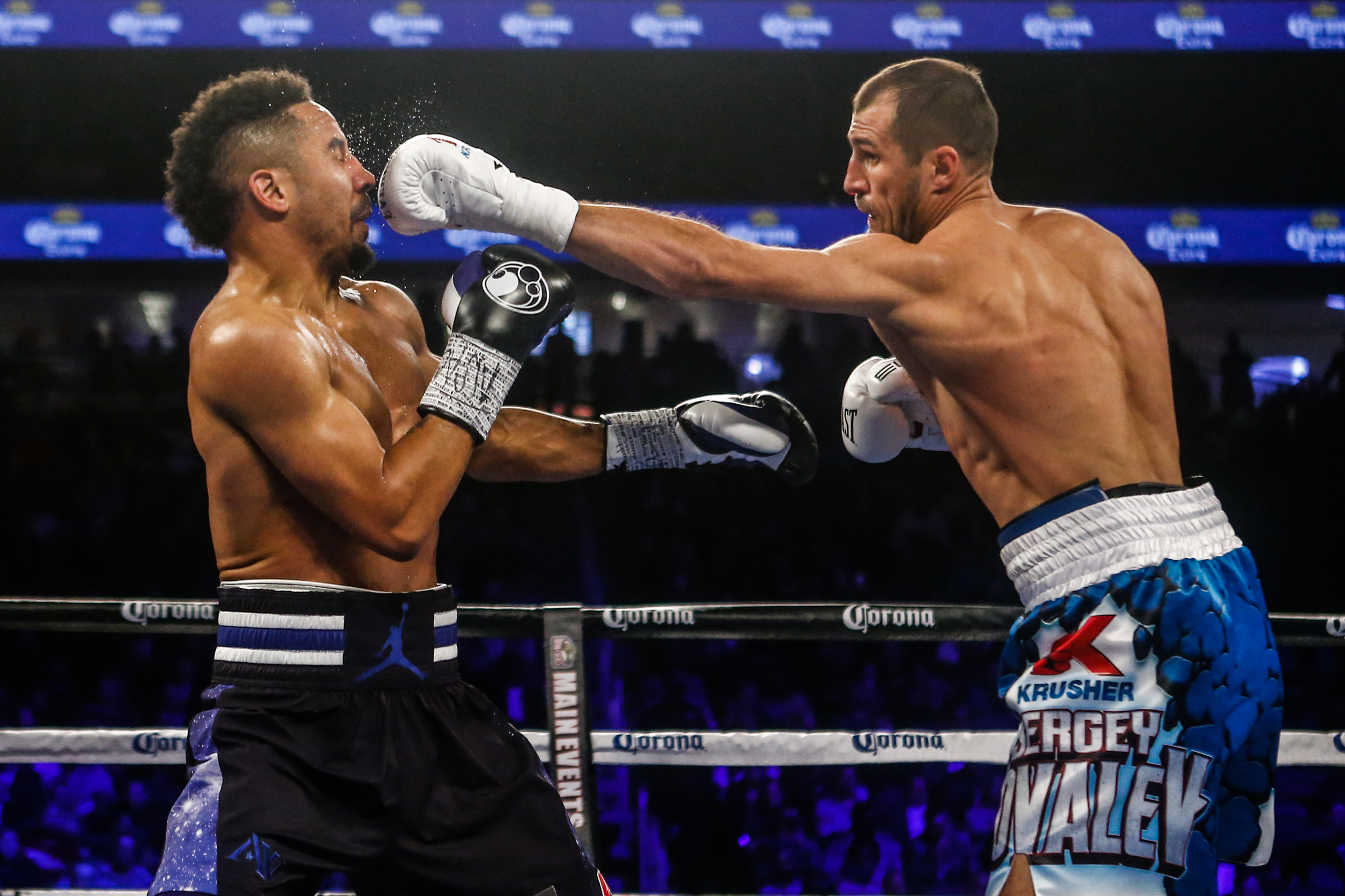 Light Heavyweight boxers Andre Ward( black trunks) and Sergey Kovalev(blue trunks) fights for the WBA/WBO/IBF world light heavyweight championship in a twelve-round bout on November 19th at the T-Mobile Arena in Las Vegas.(Anthony Geathers for ESPN)