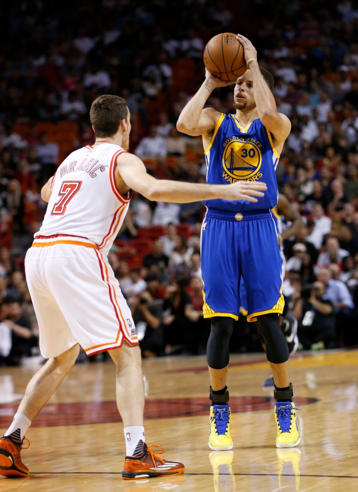 27f3829bd Golden State Warriors guard Stephen Curry (30) takes a shot against Miami  Heat guard Goran Dragic (7) during the first half of an NBA basketball  game