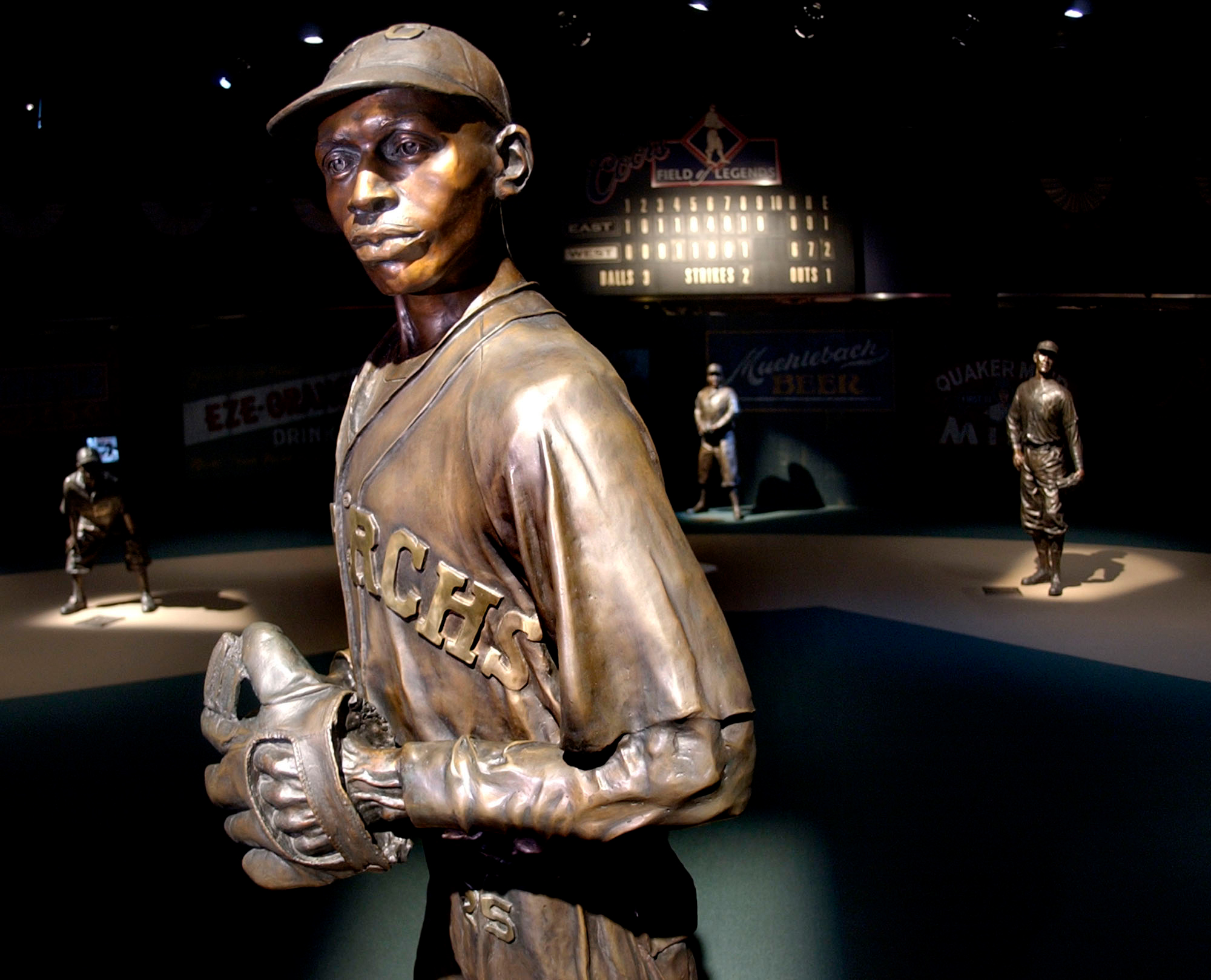 A bronze statues of Negro League greats including pitcher Satchel Paige, front, play their positions on the Field of Legends, which is the centerpiece of the Negro Leagues Baseball Museum in Kansas City, Mo.