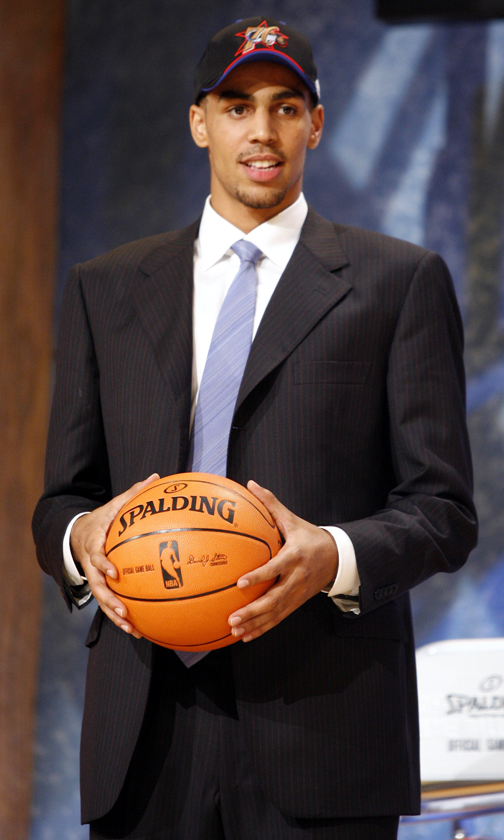 Thabo Sefolosha, a guard of Switzerland, walks to the stage after he was chosen by the Philadelphia 76ers as the 13th overall pick of the 2006 NBA Draft Wednesday June 28, 2006 at Madison Square Garden in New York. Sefolosha was then traded to the Chicago Bulls.
