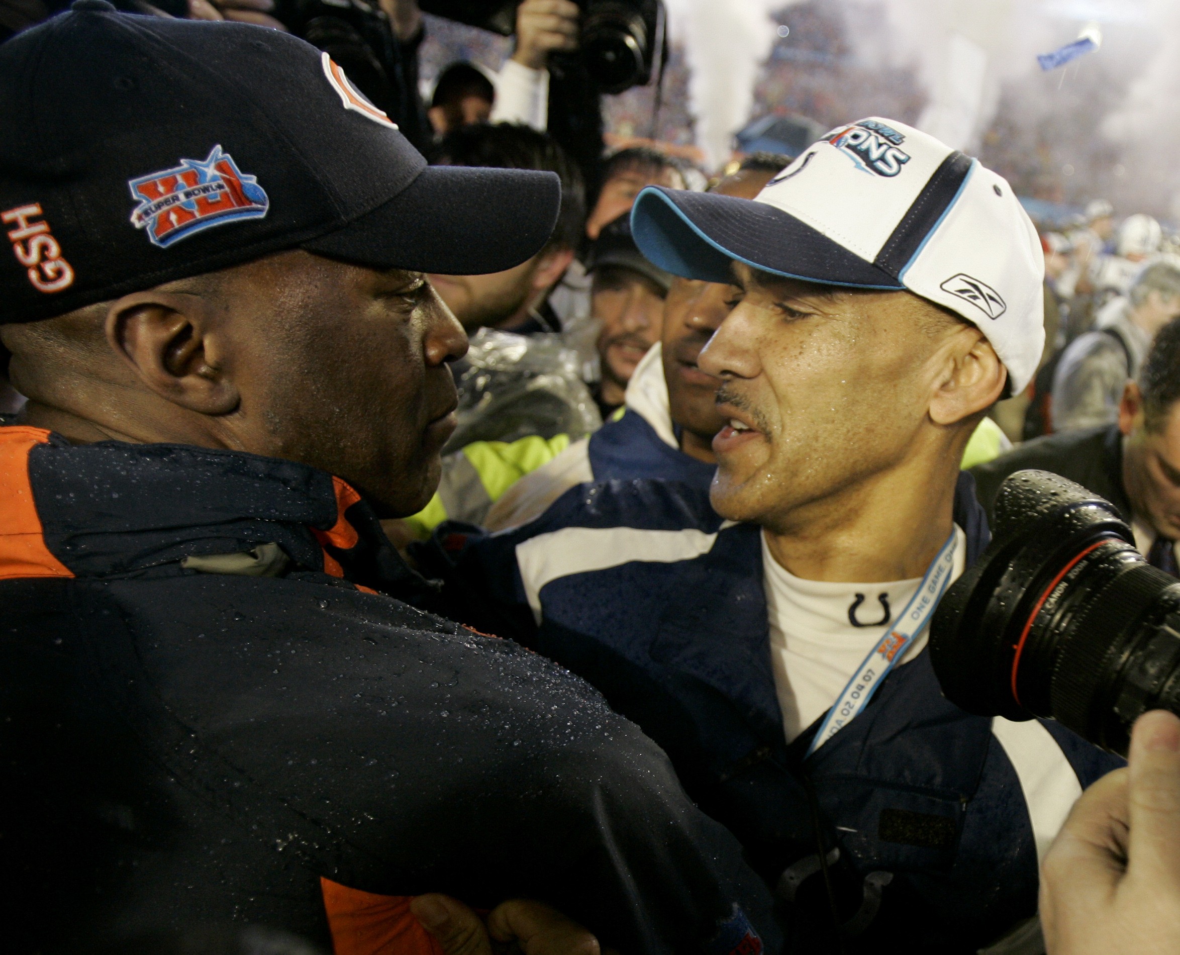 Indianapolis Colts head coach Tony Dungy, right, hugs Chicago Bears head coach Lovie Smith at the end of the Super Bowl XLI football game at Dolphin Stadium in Miami.