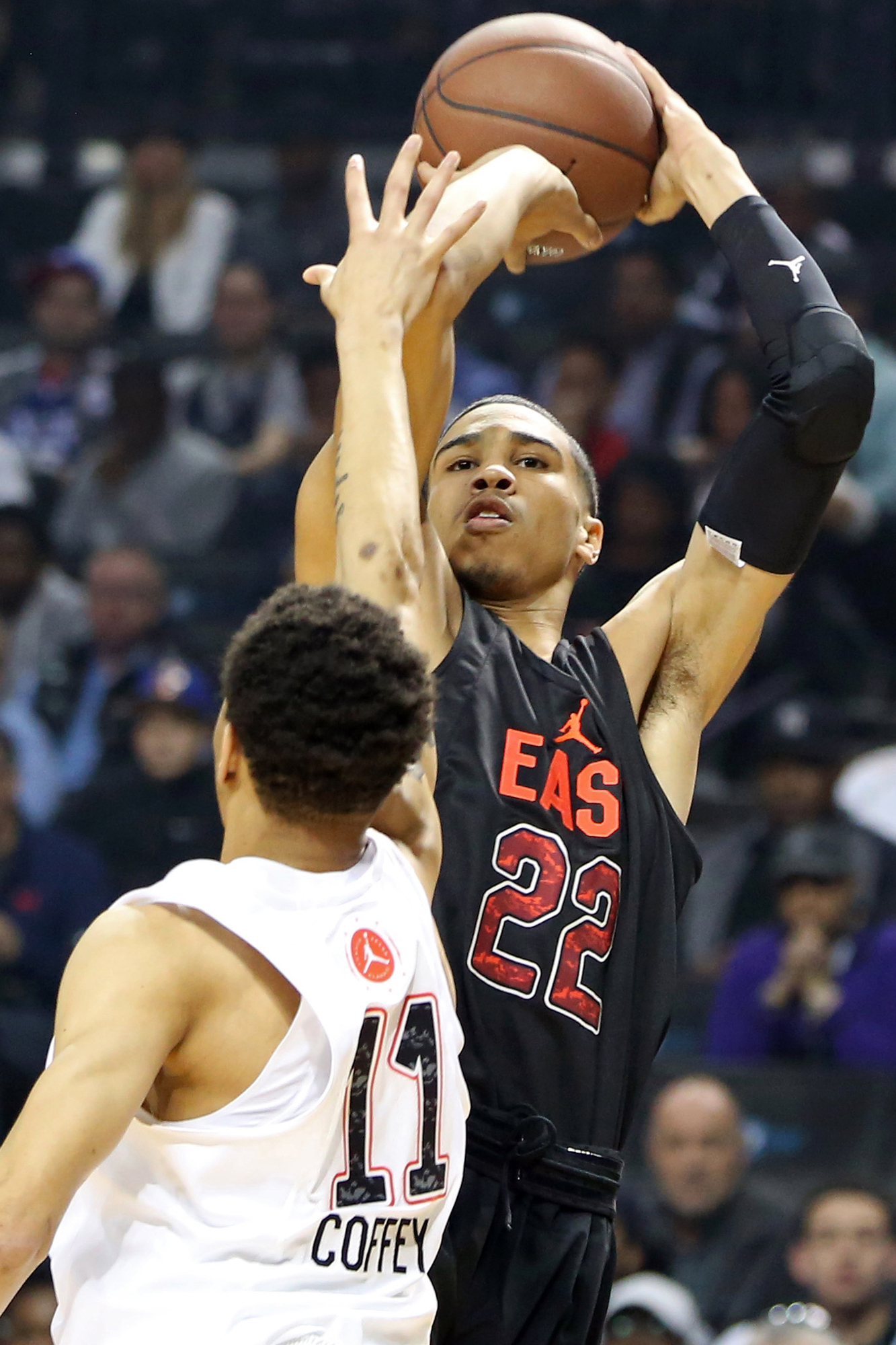 East team's Jayson Tatum, right, shoots against the West team during a high school basketball game in the Jordan Brand Classic in New York.