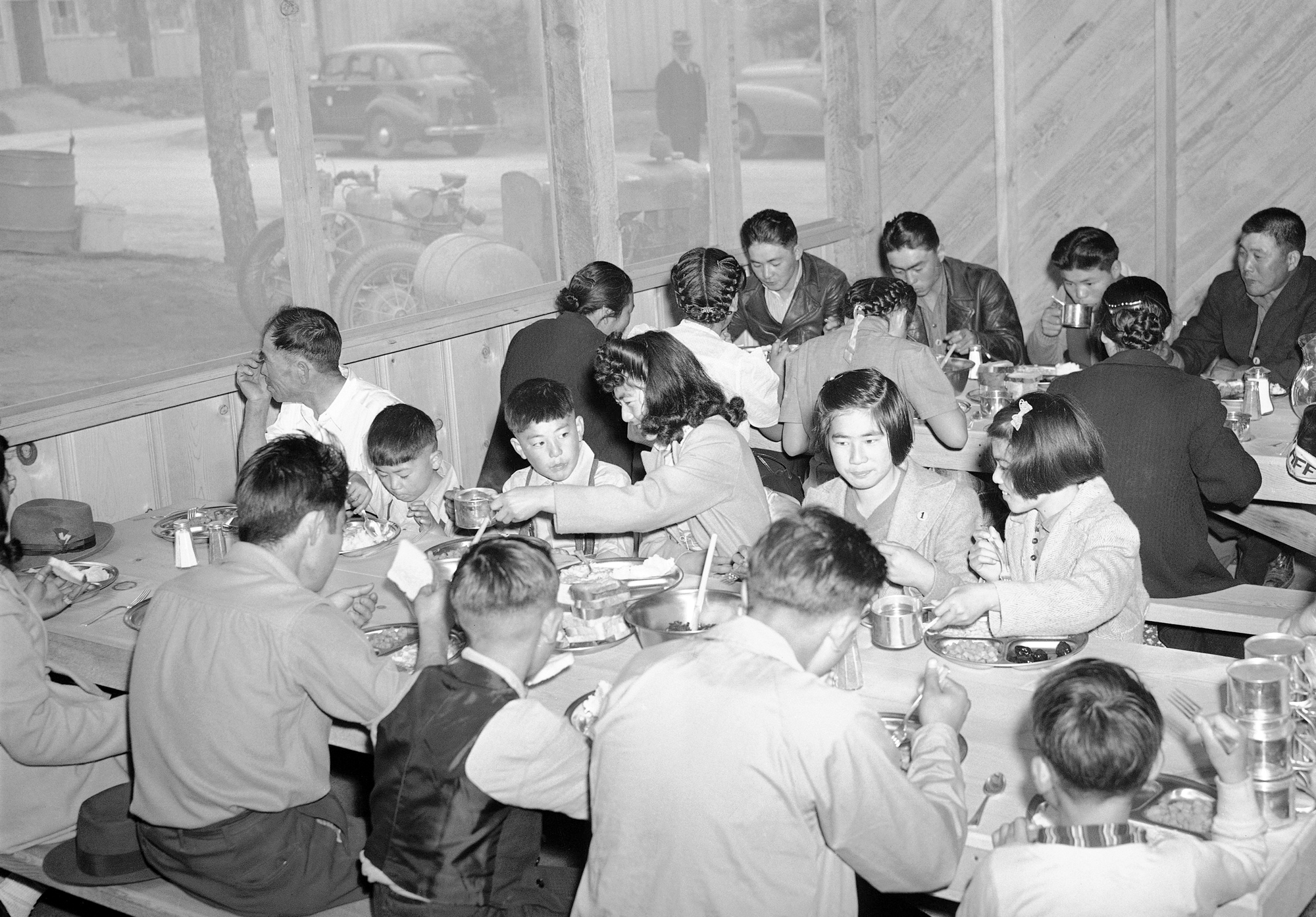 The U.S. government provided hot meals for the first Japanese at the Santa Anita Race track reception center near Los Angeles, California April 3, 1942.