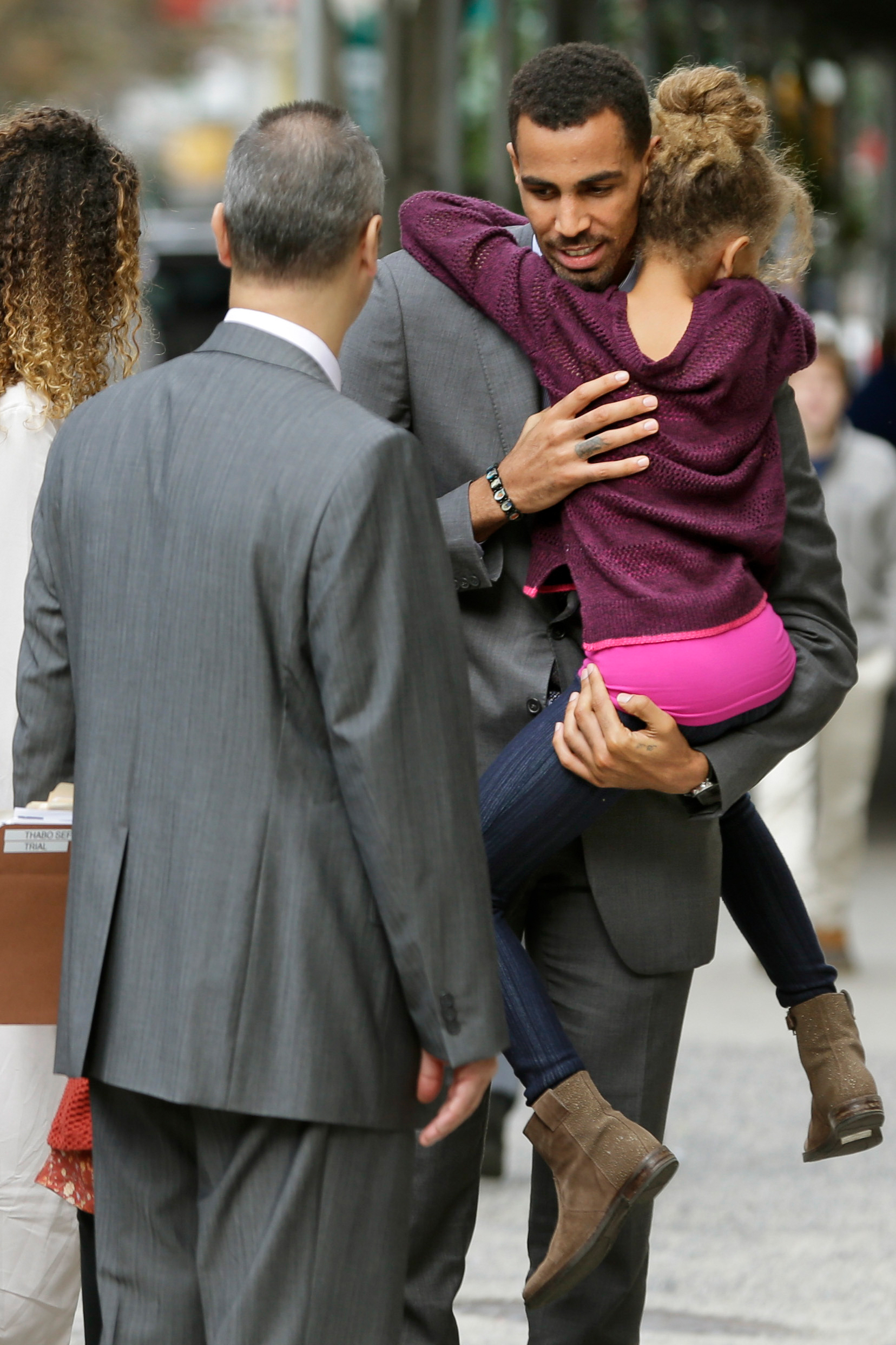 "The Atlanta Hawks' Thabo Sefolosha Thabo Sefolosha hugs a child before entering criminal court after a lunch break in New York, Thursday, Oct. 8, 2015. An NBA head coach has testified that the character of Sefolosha, a professional basketball player and Swiss national on trial after a confrontation with New York City police, is ""of the highest order."" The case stems from a struggle outside the 1Oak nightclub in Chelsea after Indiana Pacers forward Chris Copeland and two women were stabbed."