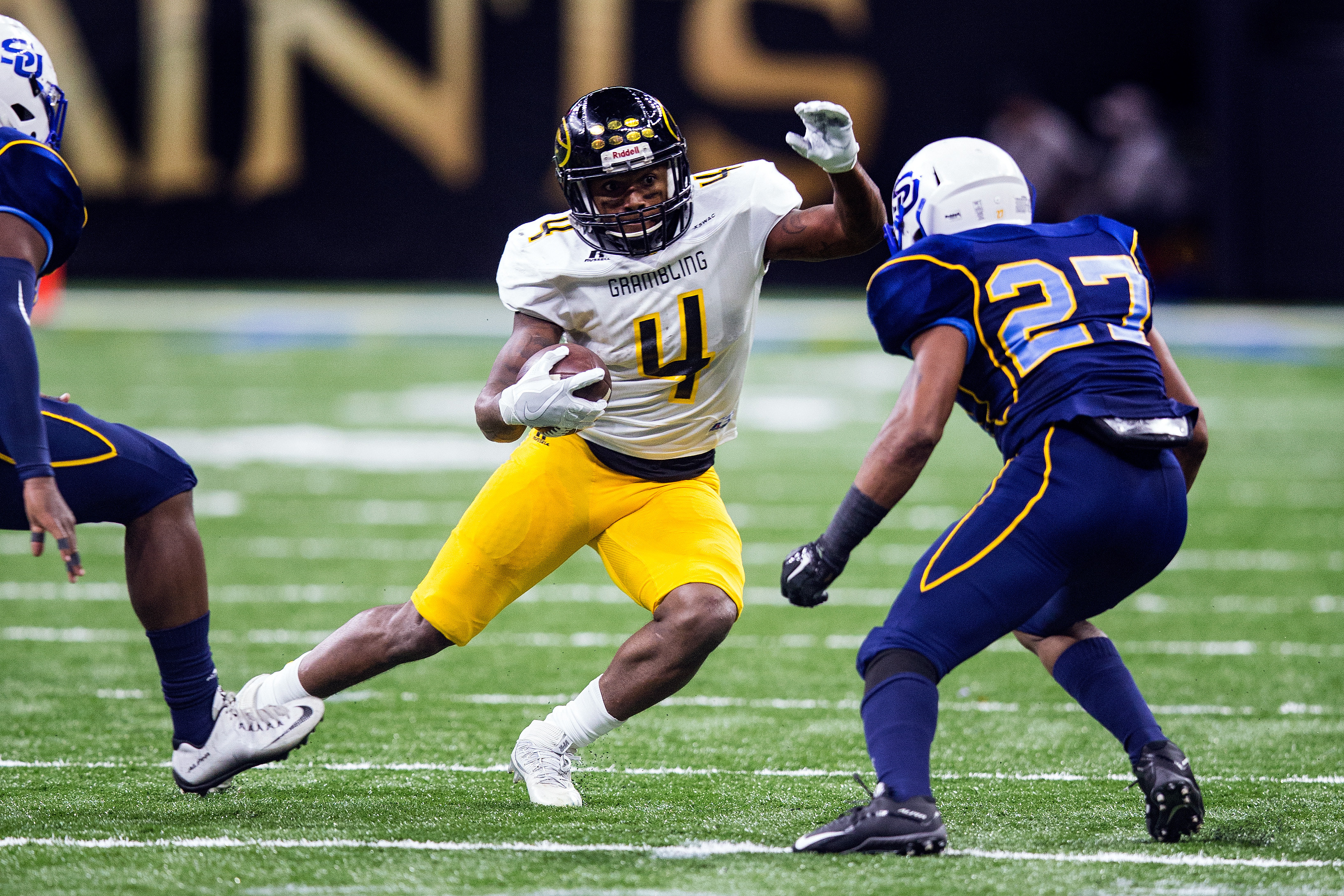 Grambling State Tigers running back Martez Carter (4) rushes the ball during the Bayou Classic with the Southern University Jaguars versus the Grambling State Tigers on November 26, 2016 at the Mercedes-Benz Superdome in New Orleans, Louisiana.