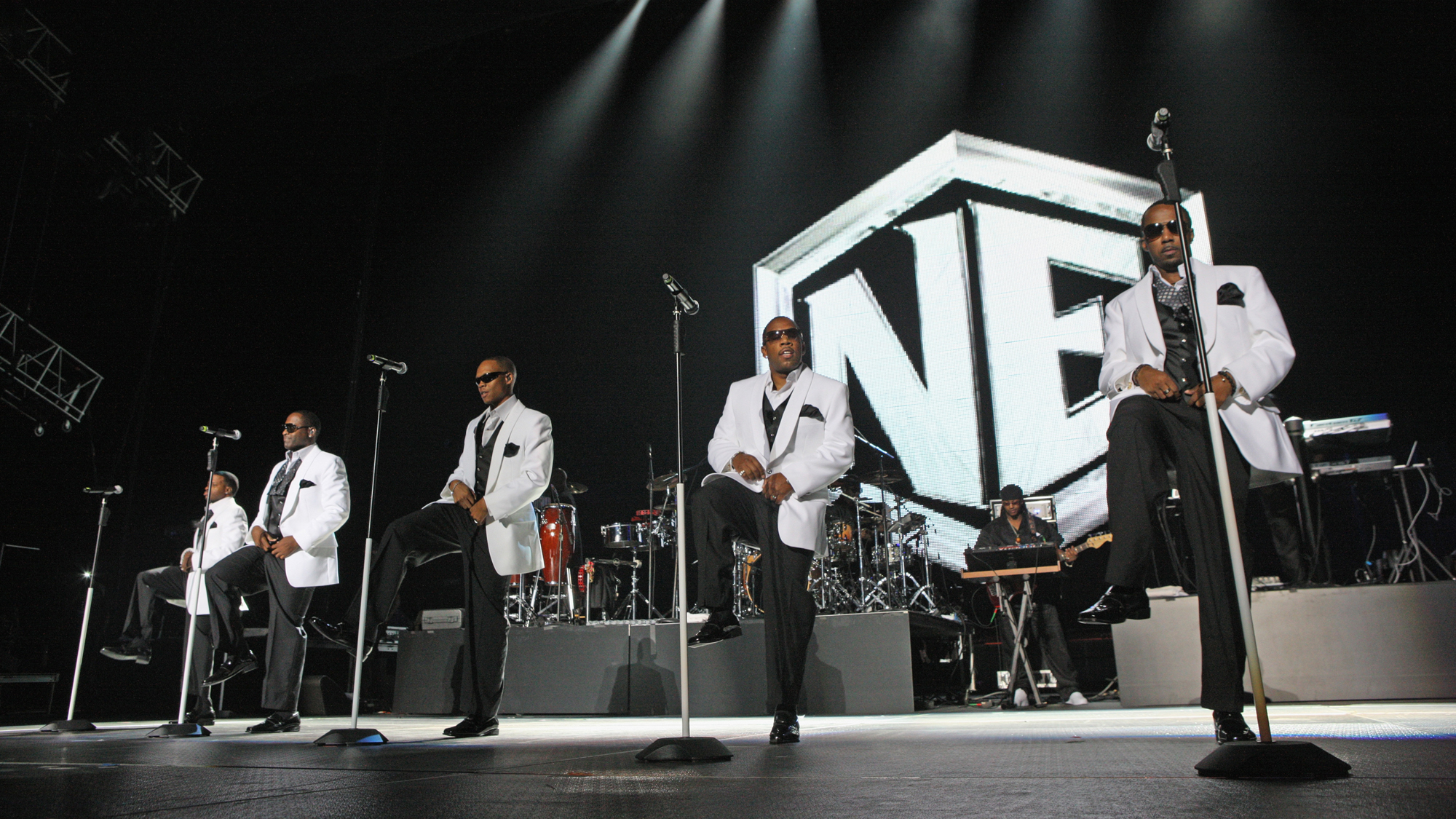(L- R) Ricky Bell, Johnny Gill Ronnie Devoe, Michael Bivins, and Ralph Tresvant of New Edition perform during the 2011 Essence Music Festival at the Louisiana Superdome on July 3, 2011 in New Orleans, Louisiana.