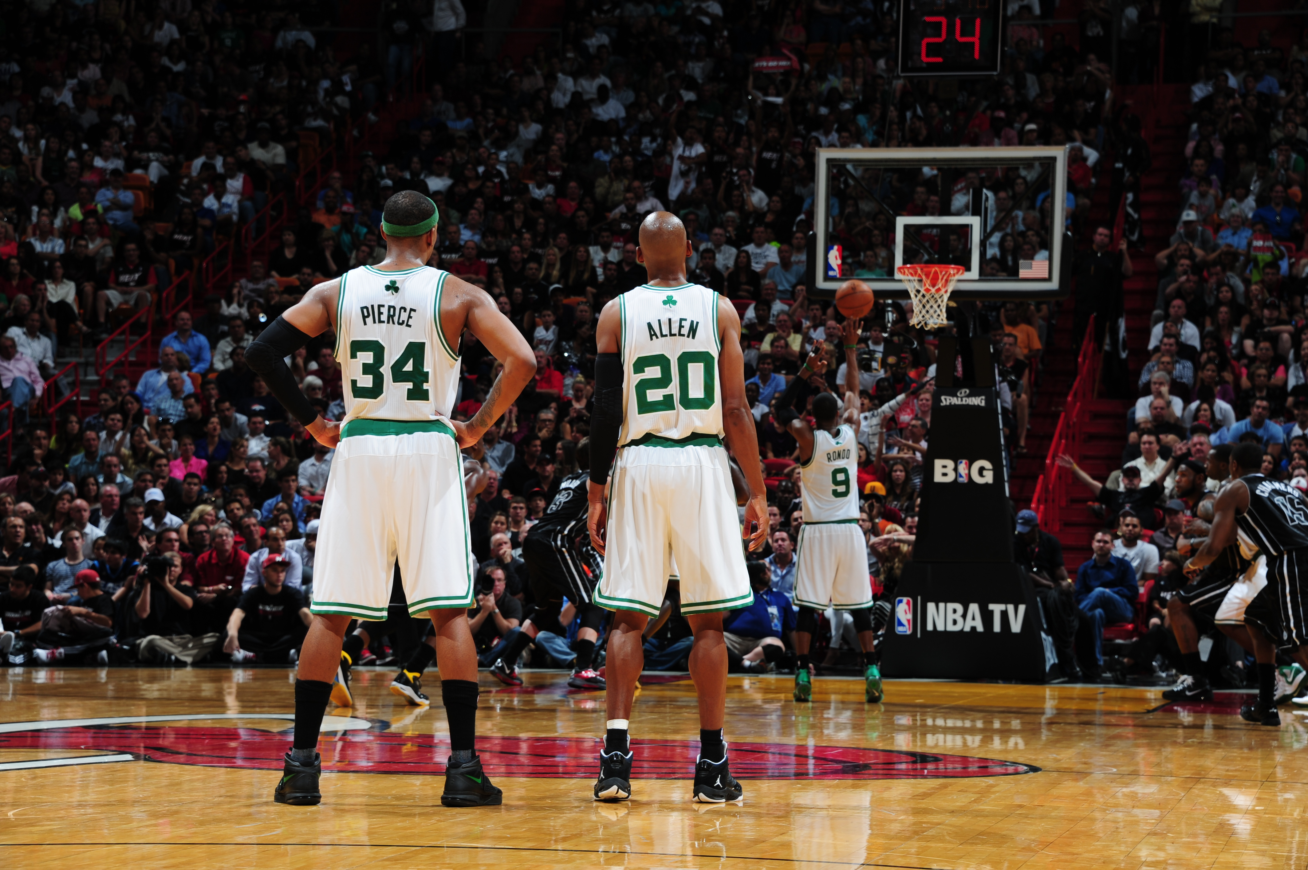 3da6addf60f4f2 Paul Pierce  34 and Ray Allen  20 of the Boston Celtics watch teammate Rajon