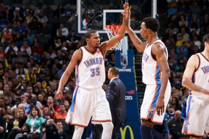 OKLAHOMA CITY, OK - FEBRUARY 6: Kevin Durant #35 and Hasheem Thabeet #34 of the Oklahoma City Thunder celebrate while playing the Golden State Warriors on February 6, 2013 at the Chesapeake Energy Arena in Oklahoma City, Oklahoma.