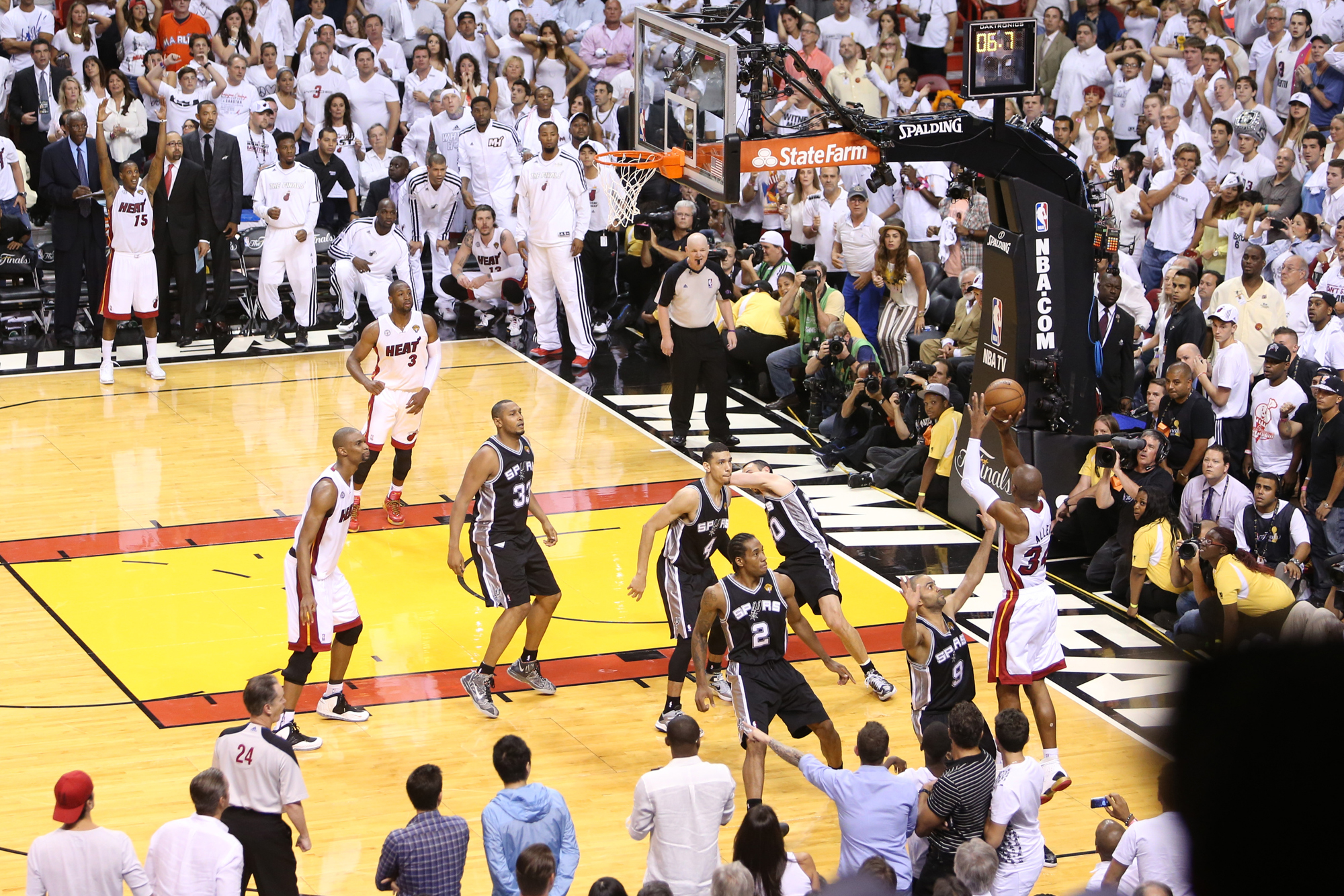 Ray Allen #34 of the Miami Heat shoots the game tying three-pointer against Tony Parker #9 of the San Antonio Spurs during Game Six of the 2013 NBA Finals on June 18, 2013 at American Airlines Arena in Miami, Florida.