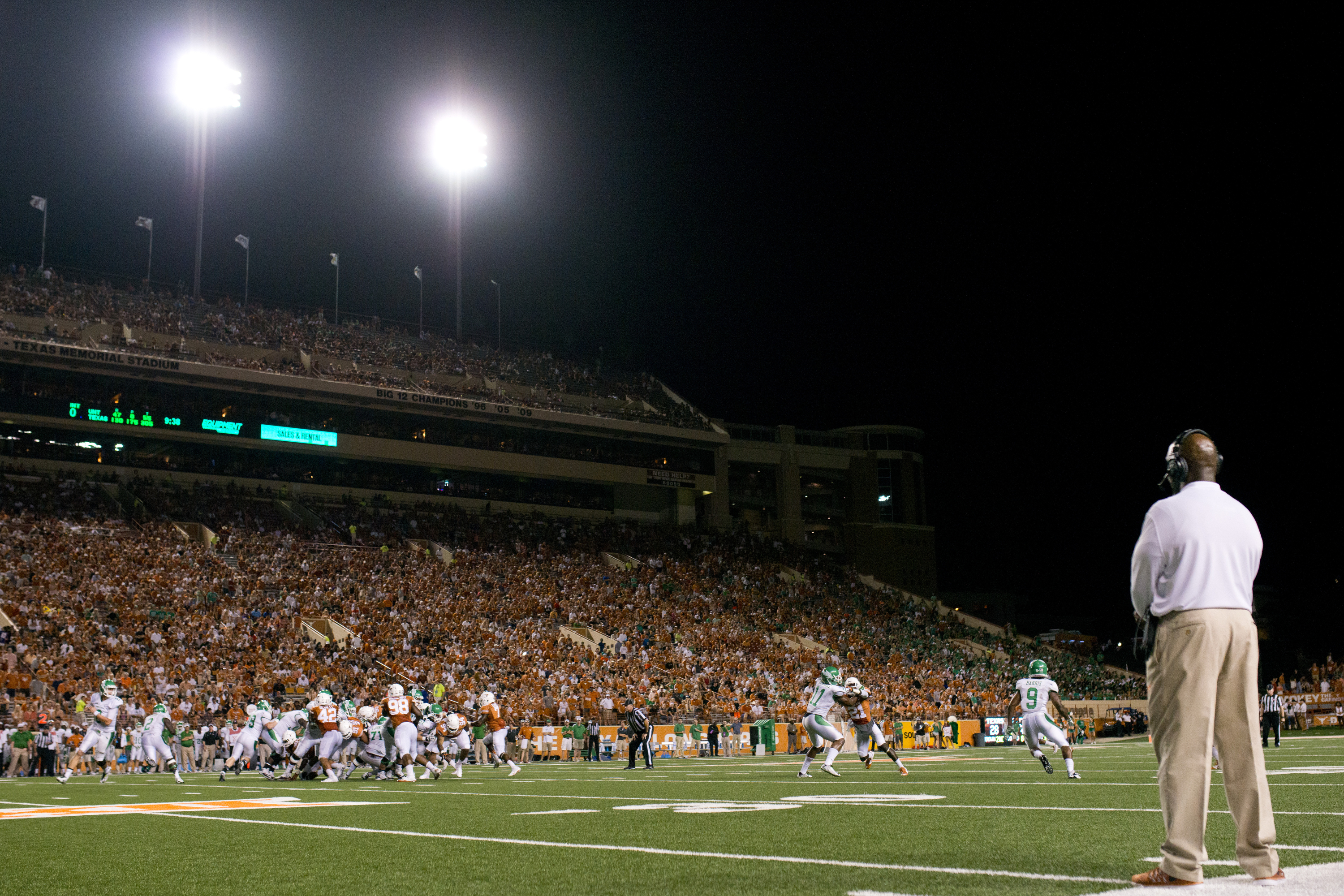 Texas Longhorns head coach Charlie Strong looks on against the North Texas Mean Green on August 30, 2014 at Darrell K Royal-Texas Memorial Stadium in Austin, Texas.