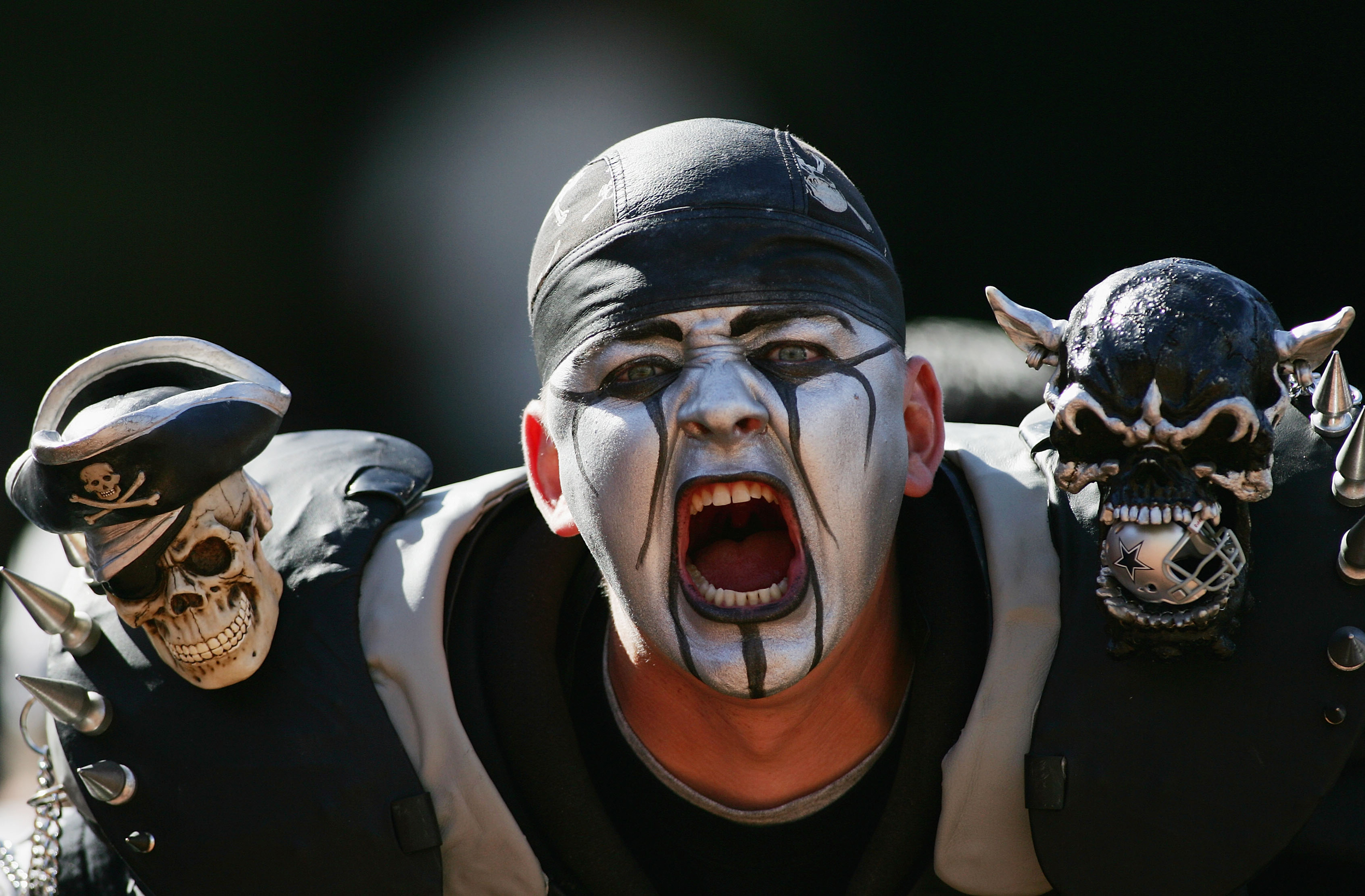 A fan of the Oakland Raiders cheers during the game against the Dallas Cowboys on October 2, 2005 at McAfee Coliseum in Oakland, California.