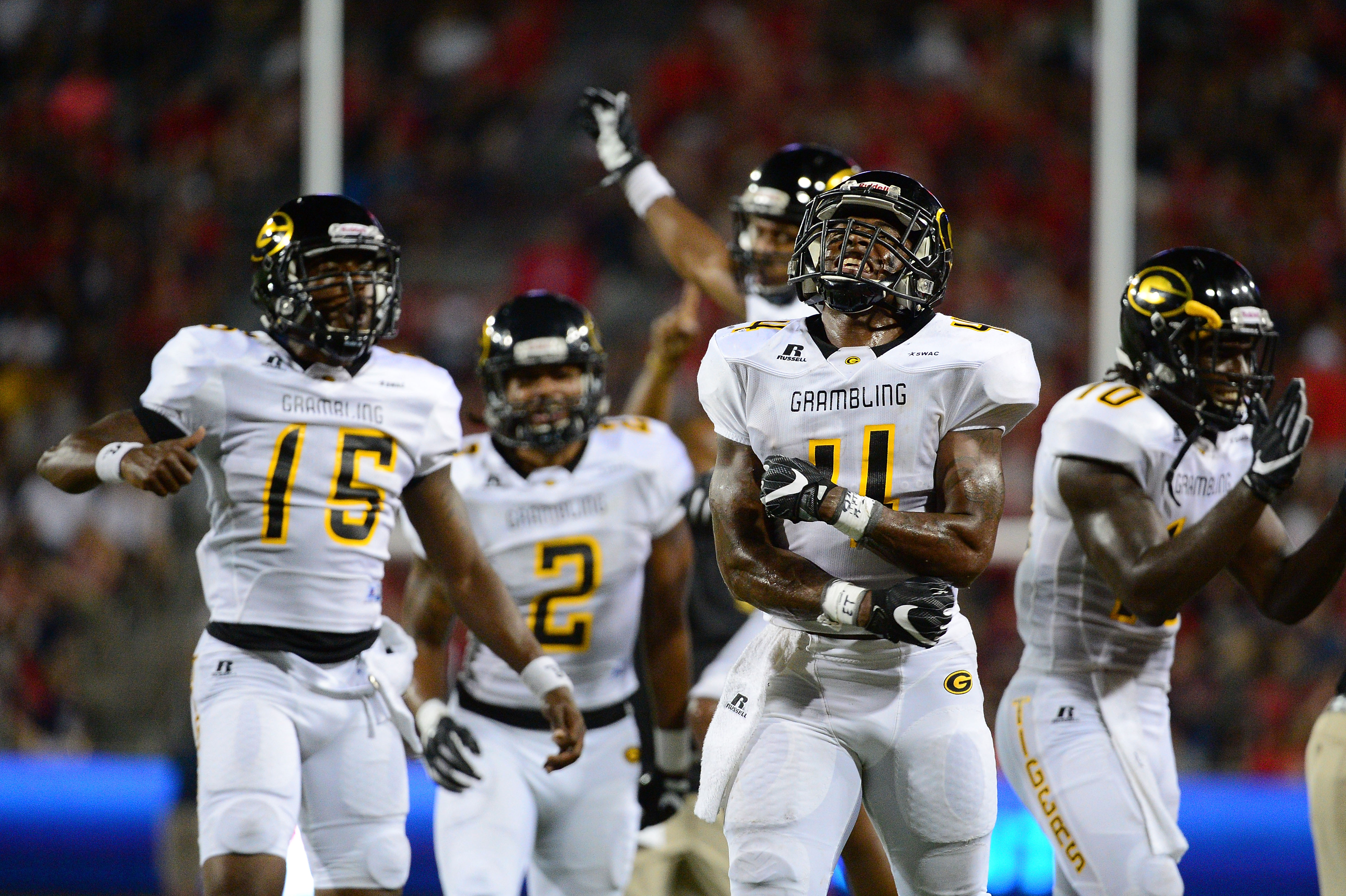 TUCSON, AZ - SEPTEMBER 10: Wide receiver Martez Carter #4 of the Grambling State Tigers celebrates with teammates after scoring a touchdown against the Arizona Wildcats in the second quarter at Arizona Stadium on September 10, 2016 in Tucson, Arizona.