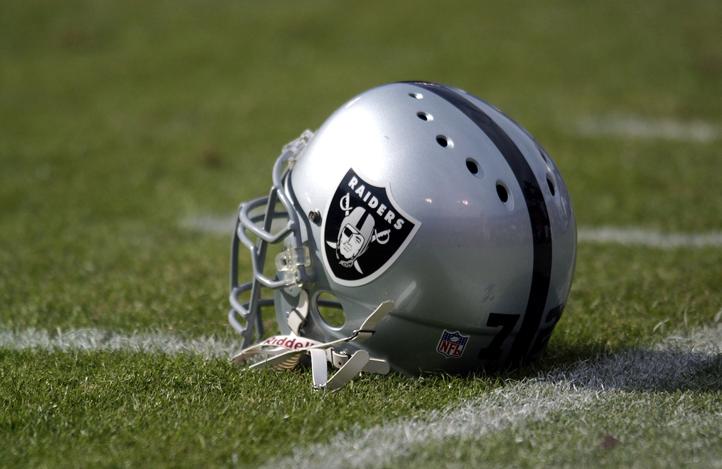 Oakland Raiders helmet on the sidelines. The 49ers defeated the Raiders, 14-10, in the NFL preseason game at 3COM Park in San Francisco, Calif. on August 14, 2003 .