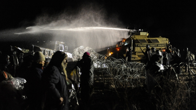 Police use a water cannon on protesters during a protest against plans to pass the Dakota Access pipeline near the Standing Rock Indian Reservation, near Cannon Ball, North Dakota, U.S.