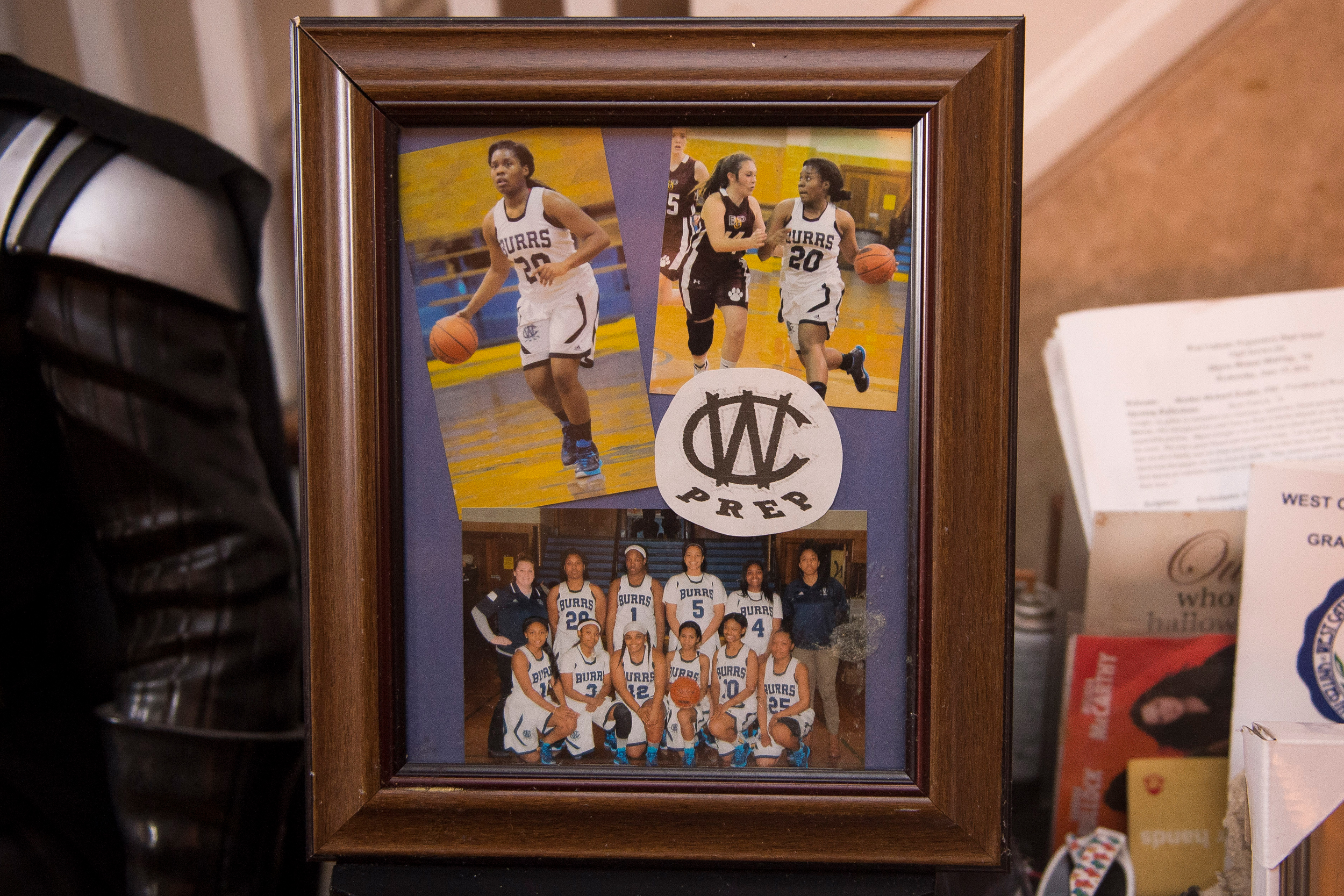 Framed photos of Akyra Murray at her parents home.