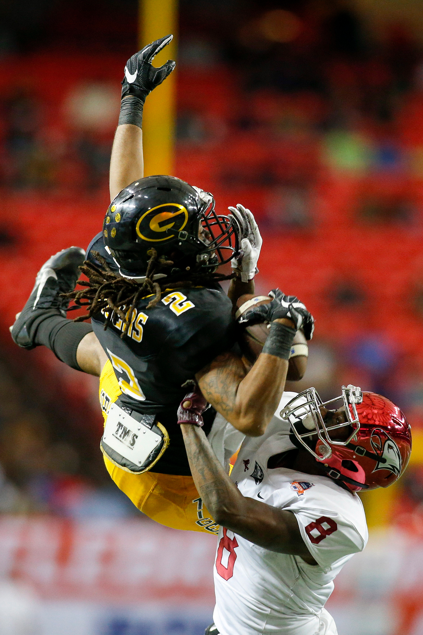 Grambling State Tigers wide receiver Verlan Hunter (2) catches a pass over North Carolina Central Eagles defensive back De'Mario Evans (8) in the fourth quarter at the Georgia Dome. The Tigers won 10-9.
