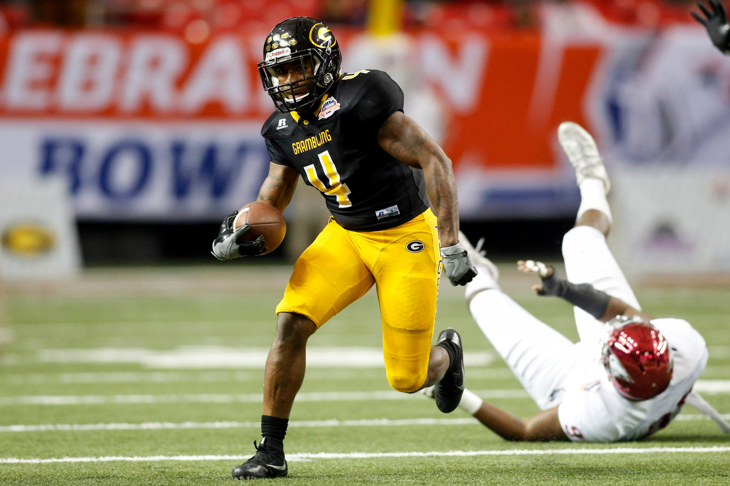Atlanta, GA, USA; Grambling State Tigers running back Martez Carter (4) runs the ball against the North Carolina Central Eagles in the second quarter at the Georgia Dome.