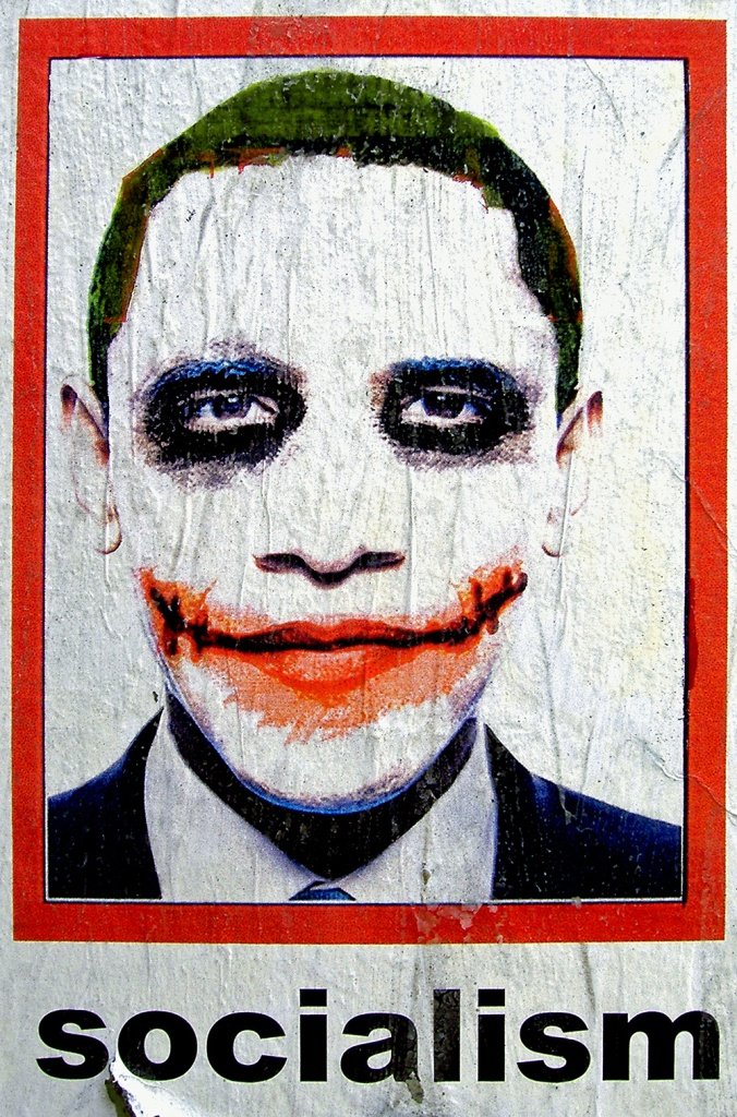 "A Chicago college posted an image of Obama as the Joker from ""The Dark Knight"" on Flickr. Someone else, presumably an Obama critic, made it into a poster and added the word ""Socialism."""