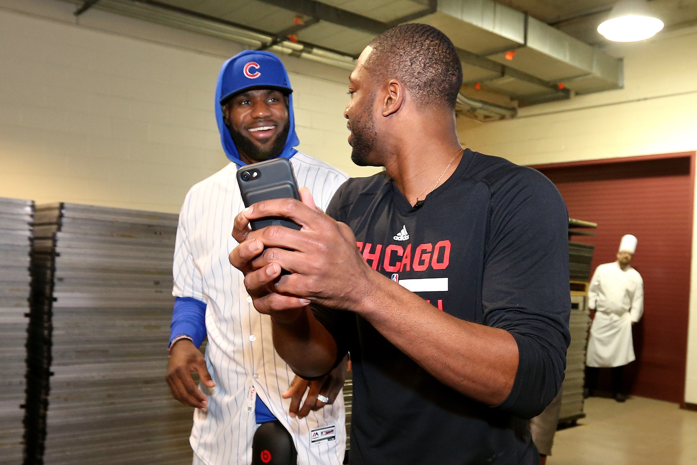 LeBron James #23 of the Cleveland Cavaliers arrives to the arena wearing a Chicago Cubs uniform and takes a picture with Dwyane Wade #3 of the Chicago Bulls before the game on December 2, 2016 at the United Center in Chicago, Illinois.
