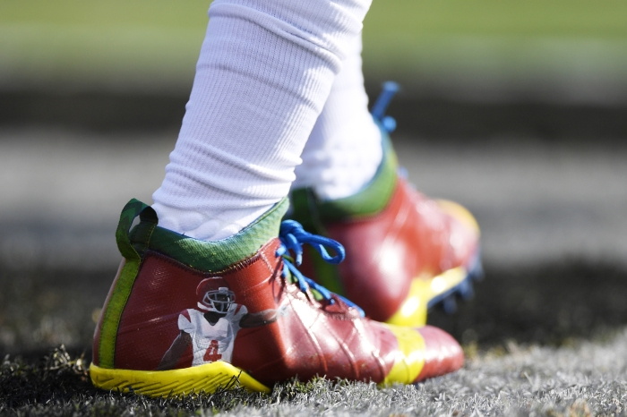 Reggie Bush #22 of the Buffalo Bills wears special cleats in memory of former NFL player Joe McKnight prior to their NFL game against the Oakland Raiders at Oakland Alameda Coliseum on December 4, 2016 in Oakland, California. McKnight was shot and killed in Terrytown, Louisiana on Thursday.