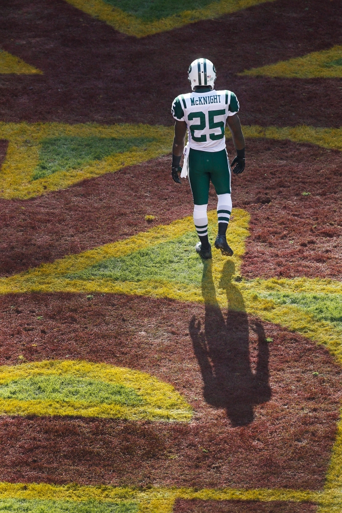 New York Jets running back Joe McKnight walks through the end zone during the half of an NFL football game against the Washington Redskins in Landover, Md., Sunday, Dec. 4, 2011.