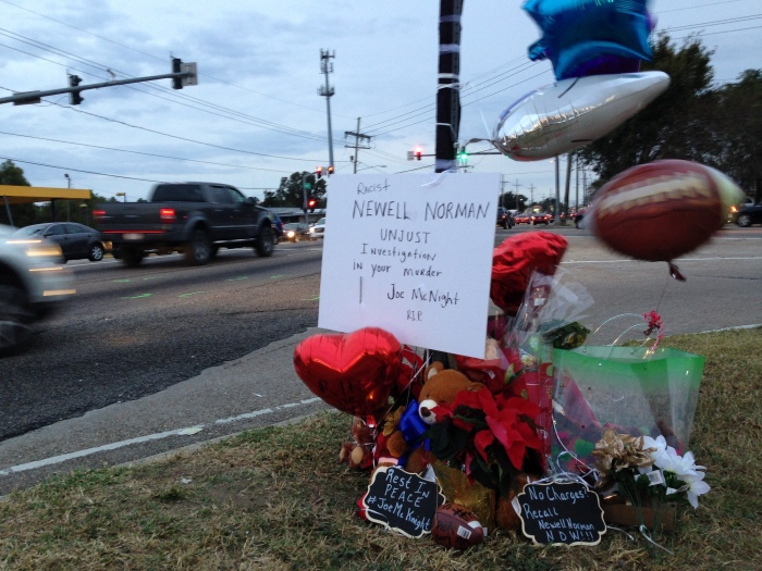Balloons, flowers and stuffed animals well-wishers left at the intersection where ex-NFL player Joe McKnight was shot Thursday and killed during a road rage incident in Terrytown, La., Friday, Dec. 2, 2016. A sheriff said the man who shot McKnight in the incident was involved in an altercation a decade ago in which he struck another driver.