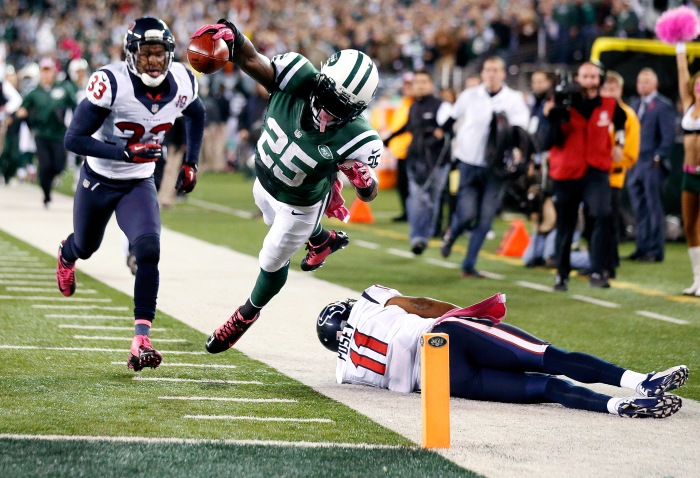 New York Jets running back Joe McKnight (25) dives into the end zone for a touchdown as Houston Texans' DeVier Posey (11) and Troy Nolan (33) trail during the second half of an NFL football game, Monday, Oct. 8, 2012, in East Rutherford, N.J.