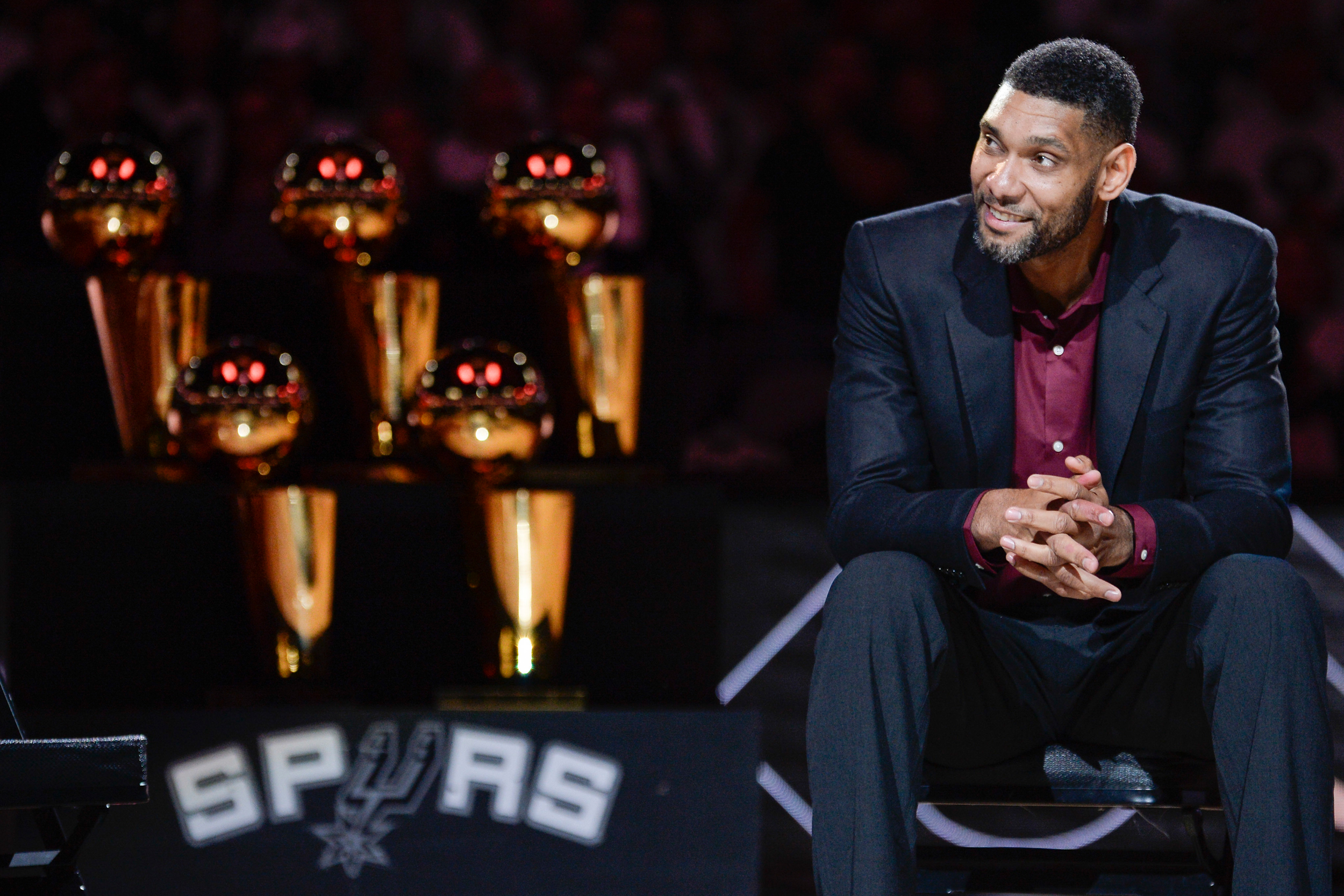 San Antonio Spurs' Tim Duncan listens while special guests speak about him during his jersey retirement ceremony, Sunday, Dec. 18, 2016, in San Antonio.