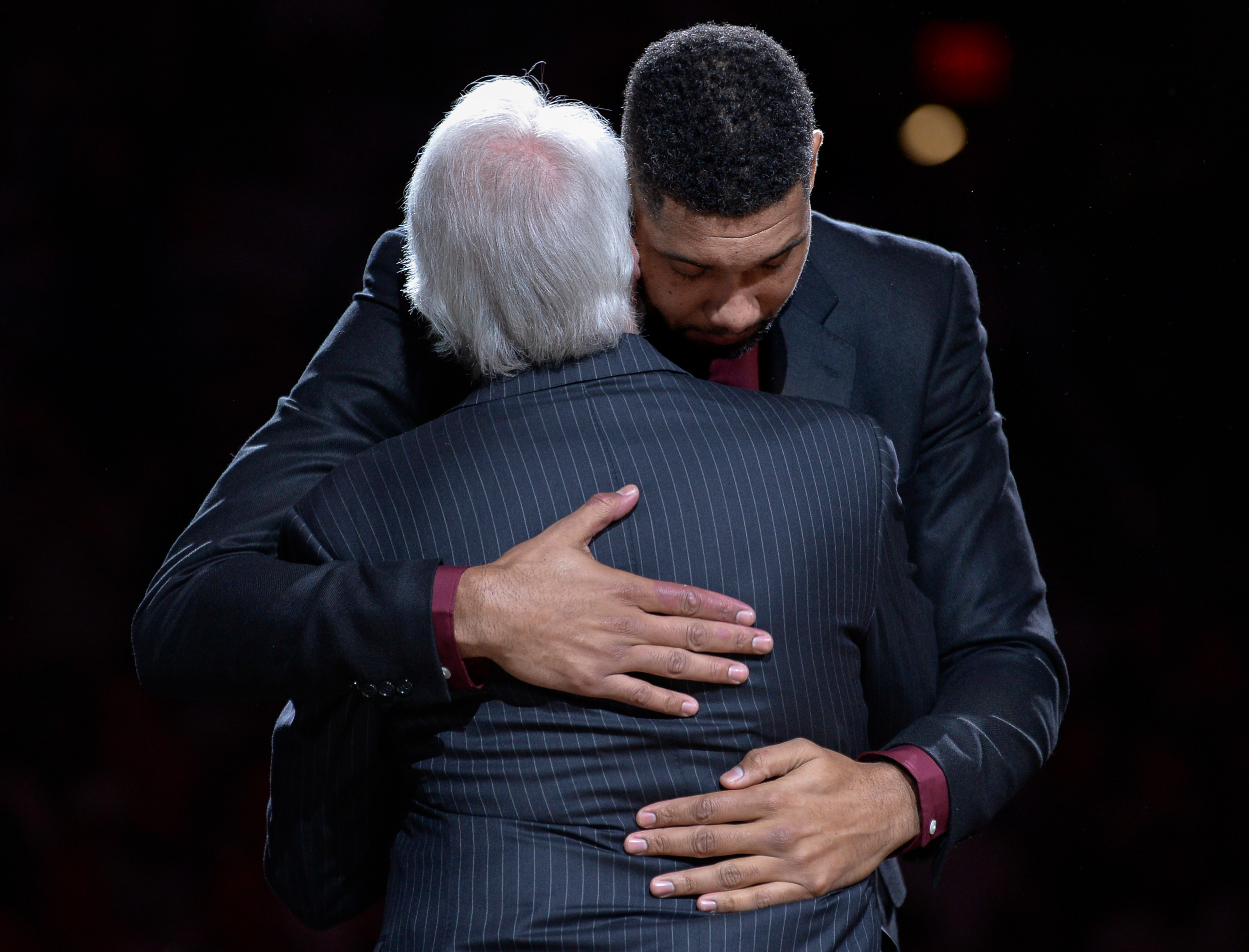 San Antonio Spurs legend Tim Duncan, right, hugs Spurs head coach Gregg Popovich during Duncan's jersey retirement ceremony, Sunday, Dec. 18, 2016, in San Antonio.